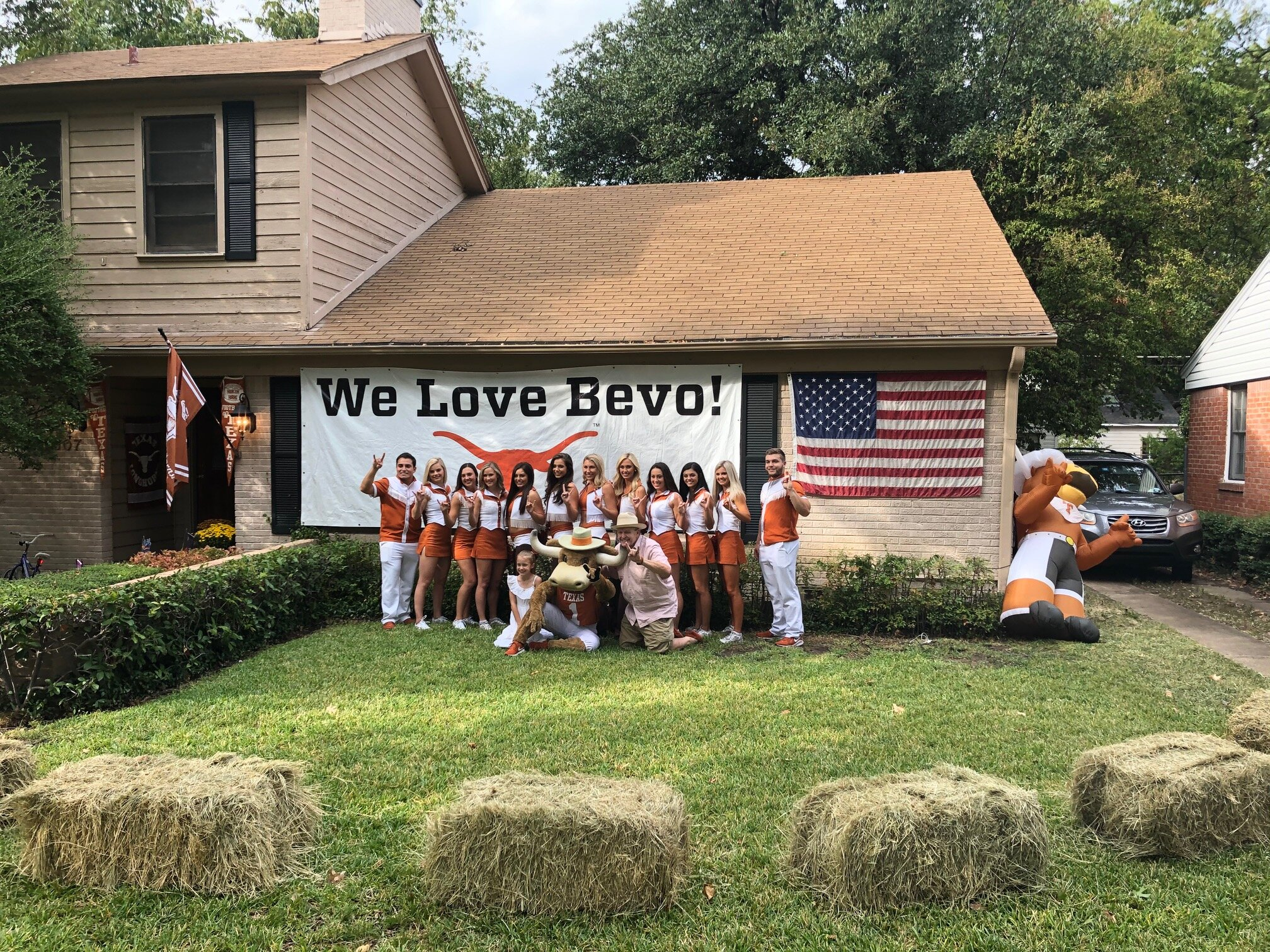 Texas Cheerleaders with costumed mascot, Hook Em' at the Hook Em' Hut in Dallas