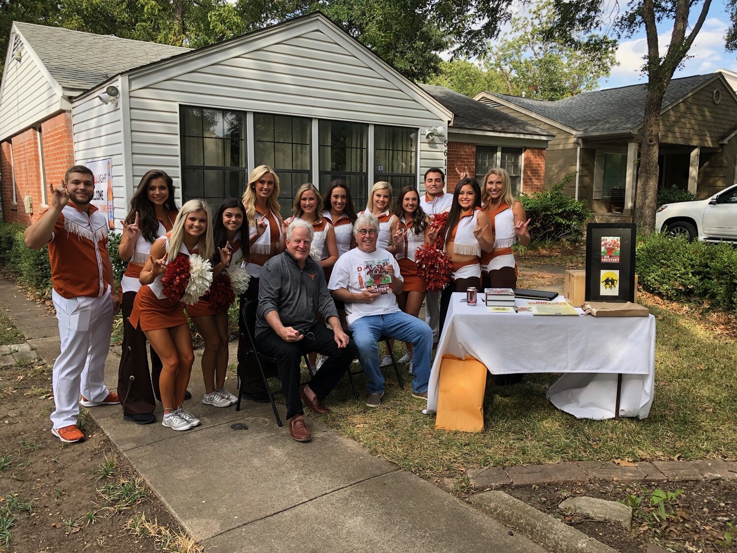 Texas Cheerleaders join author Mike Looney in promoting his new boo k The Big Shootout