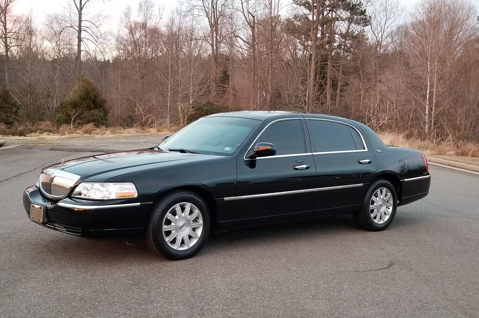 Lincoln Town Car Sedan Seating for 2 Passengers.