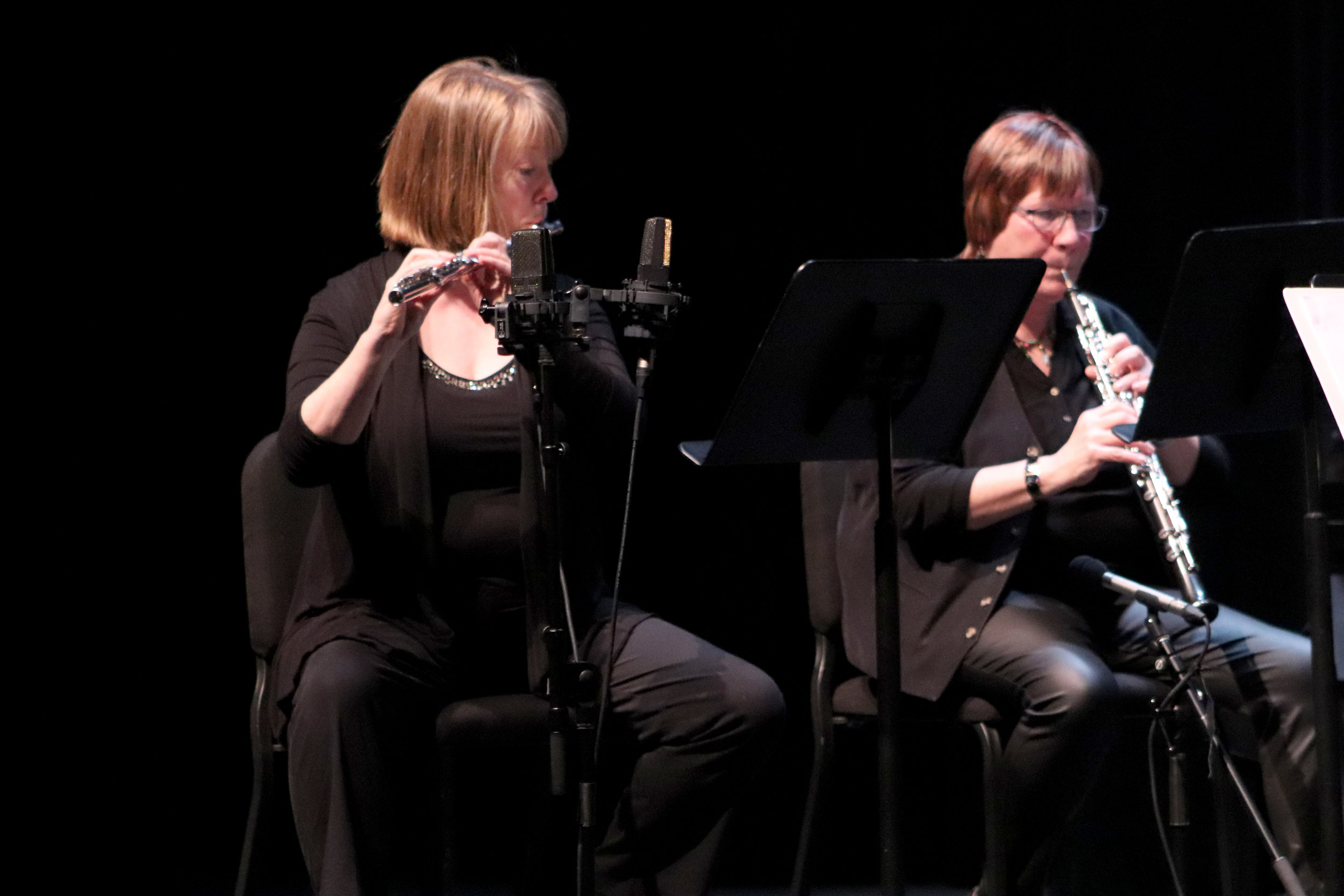 Kelly Hill Kretzer plays the flute and Ann Augustine on the obe