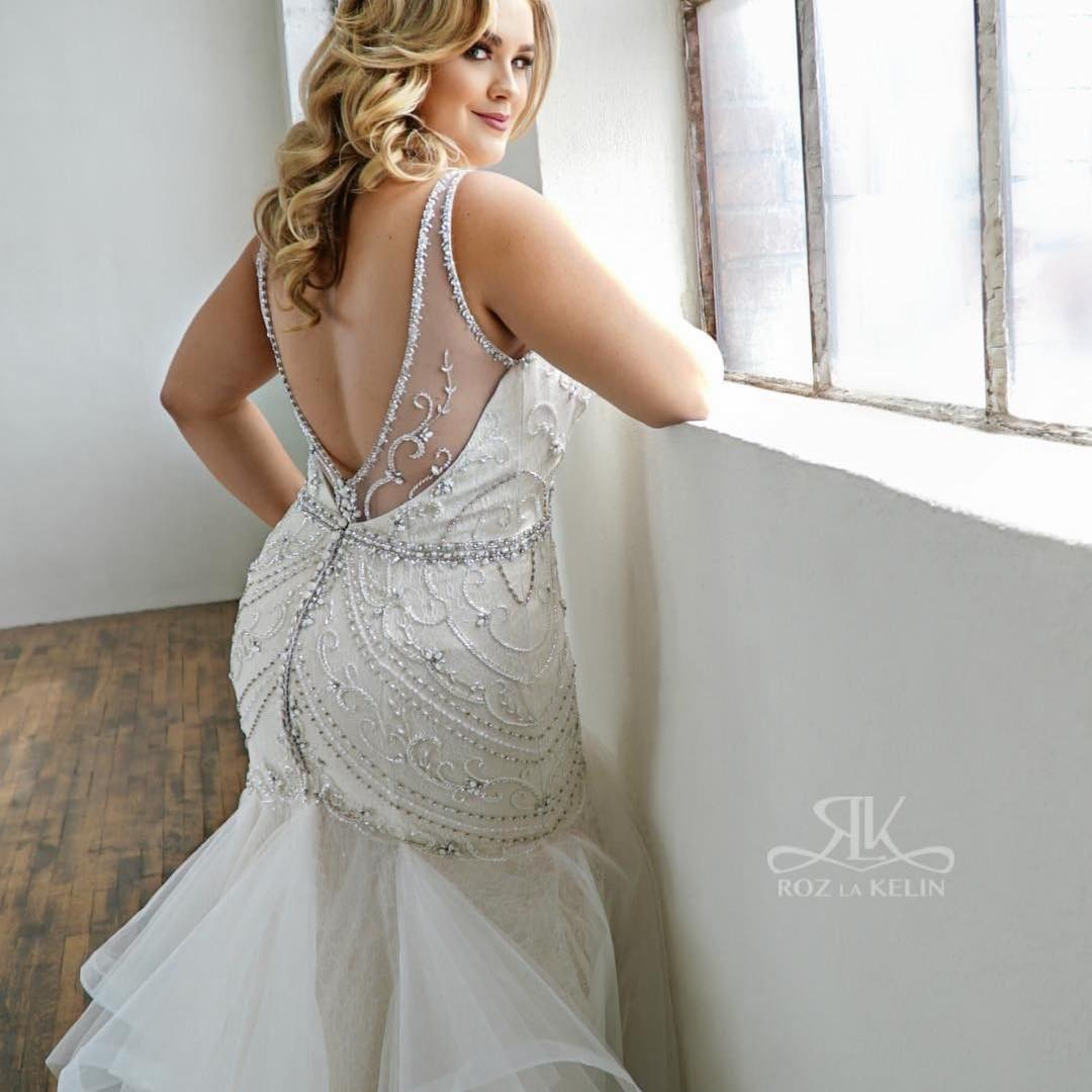 "belle_curvy_couture    We see you looking! 😉 .  #Repost  @glamourplusbridal with @get_repost  ・・・ ""I wanted to design a gown that would elegantly show off a curvy silhouette while offering feminine details of intricate beading and playful texture."" . Introducing the #Evelyn gown to the Glamour Plus Collection- expertly designed by Roz la Kelin for sizes 12 - 44 US. 💜 .  #glamourplus  #rozlakelin  #weddinginspo  #weddingdress  #plussizebride  #curvybride  #curvegoddess  #plussizeweddingdress  #bridal  #bride  #plussizebridal  #bohobride  #bohobridal  #bohoweddingdress  #bohobabe  #plussizeboho  #glamourplusbridal  #uniqueweddingdress  #bridalgown  #gardenwedding  #beachwedding  #realbride  #realwedding  #marriagegoals  #bohemian  #mermaid  #mermaidweddingdress  #curvesarebeautiful"