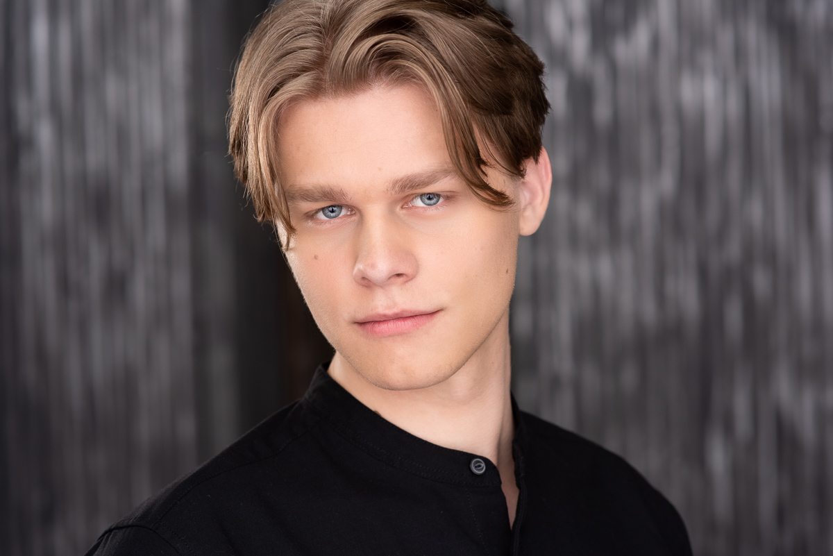 A great headshot with black means matching the tone and only showing a little of the shirt.