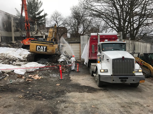 Wetting of debris while being loaded into the truck (front), wetting of building during demolition (back) - 1/7/2019 10:35am