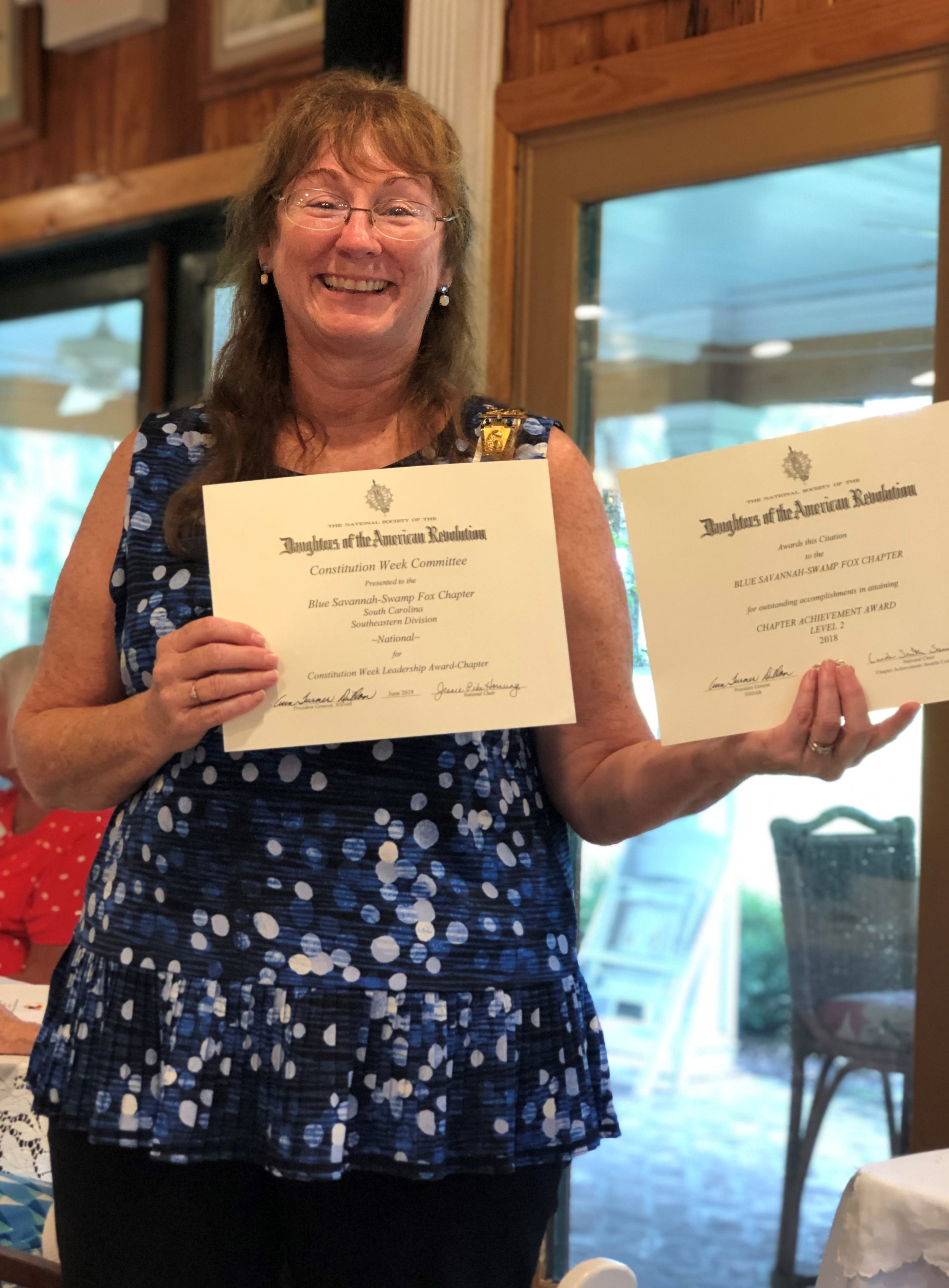 Dianne with Certificates .jpg