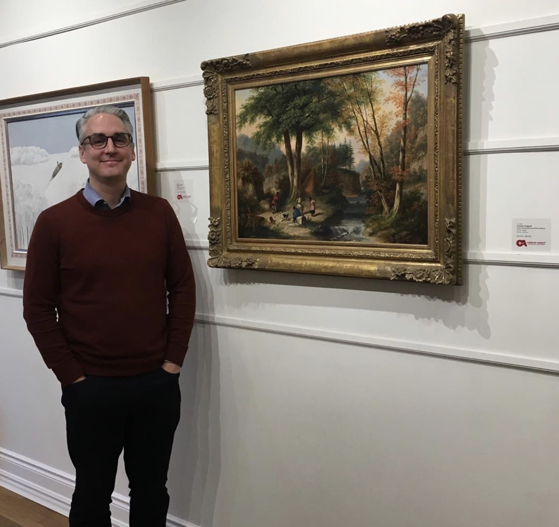 Cowley with a painting by Cornelius Krieghoff from Cowley Abbott's 2019 fall auction