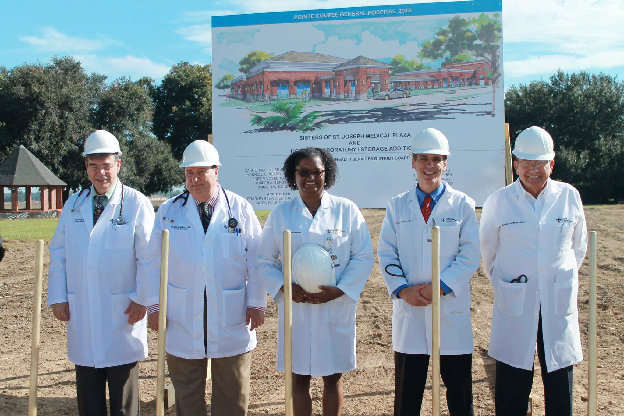 Our Lady of the Lake physicians (left to right) Dr. Paul Rachal, Dr. Carl McLemore, Dr. Carol Swift, Dr. Brian LeBlanc, and Dr. Louis Montelaro pose for photos in front of the future site of their new offices.