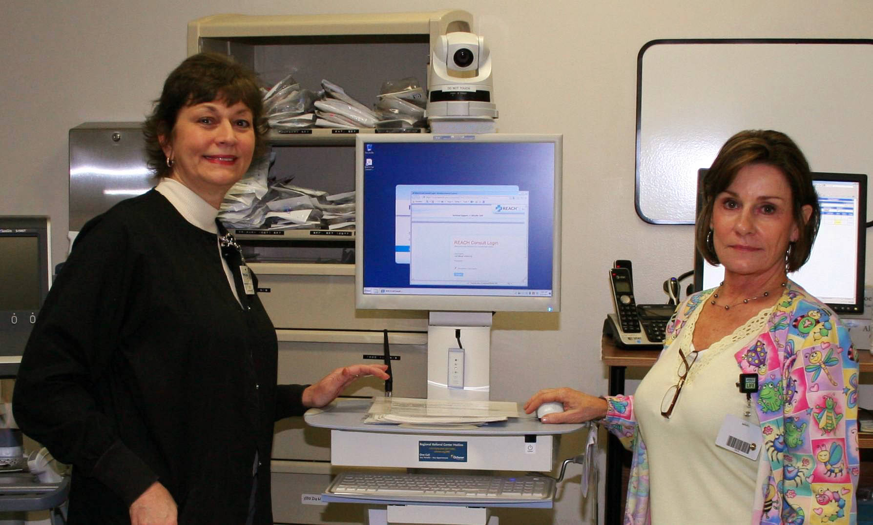 Elaine Hurme, PhD, RN and Debbie Bourgoyne, RN, ED Manager, demonstrate the new Telestroke technology located in the Emergency Department.