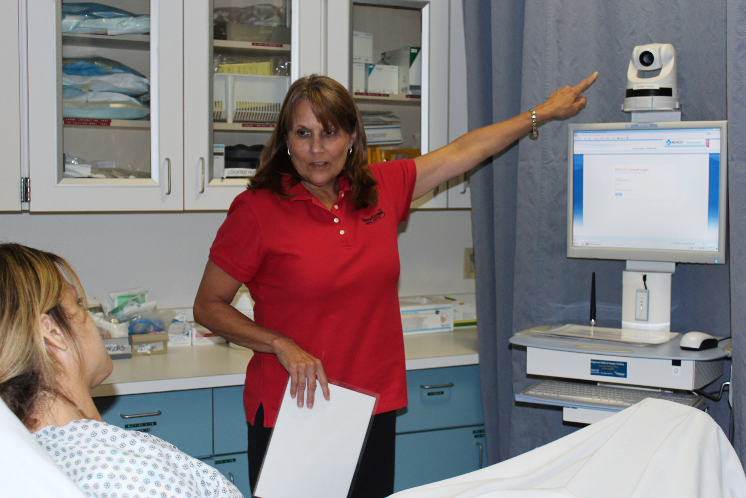 Theresa Moniotte, RN, explains TeleStroke to a patient.