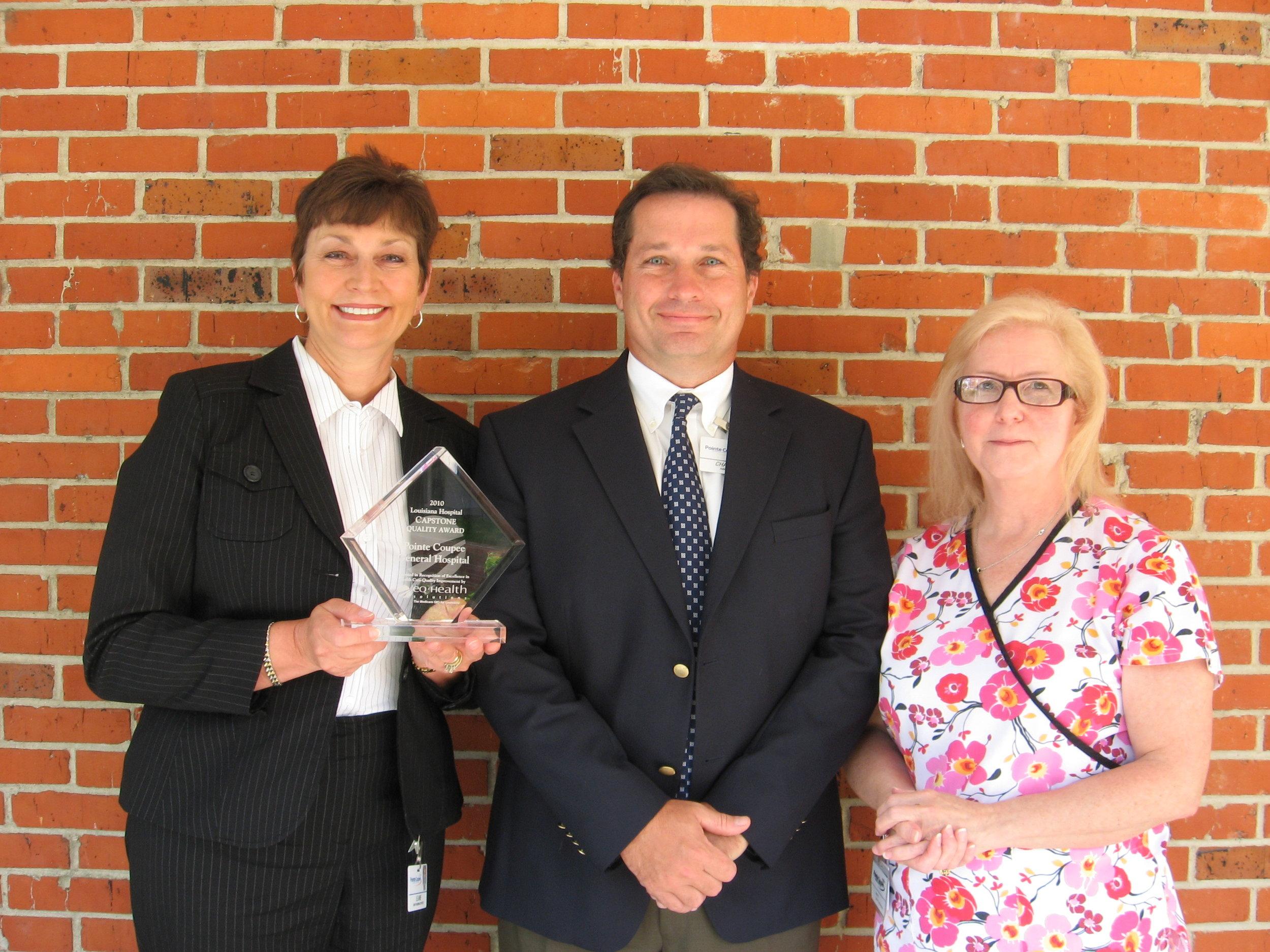 Elaine Hurme, Chad Olinde, and Maggie Jarreau showcase PCGH's Louisiana Hospital Capstone Quality award.