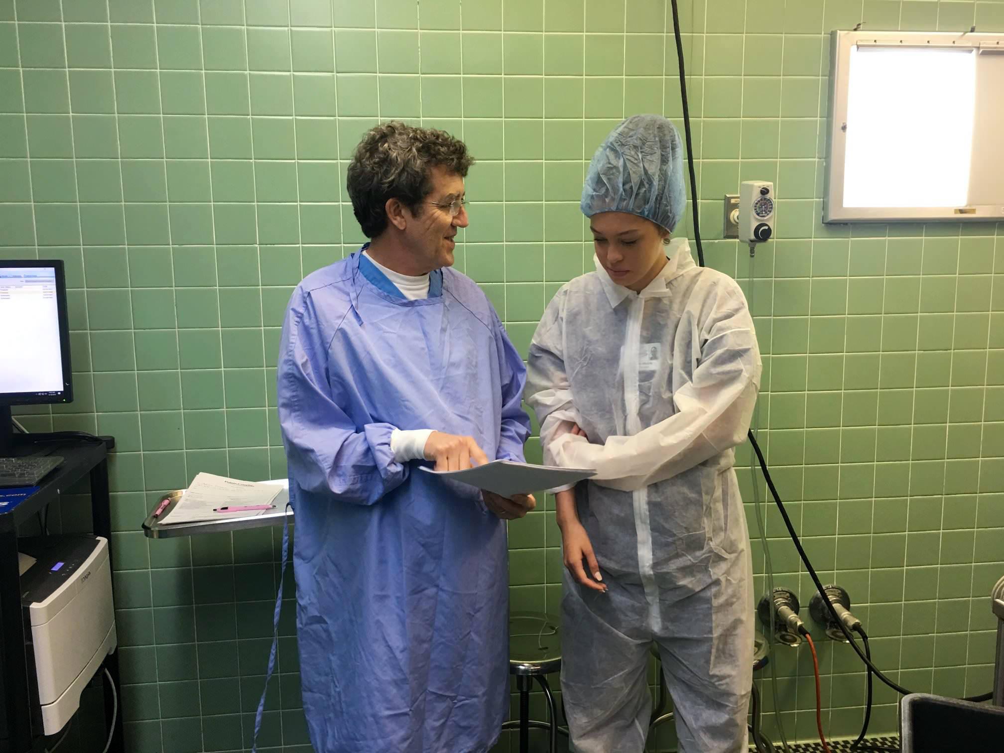 Dr. Doucet goes over operating room procedures with Lauren Webre (CHSPC).