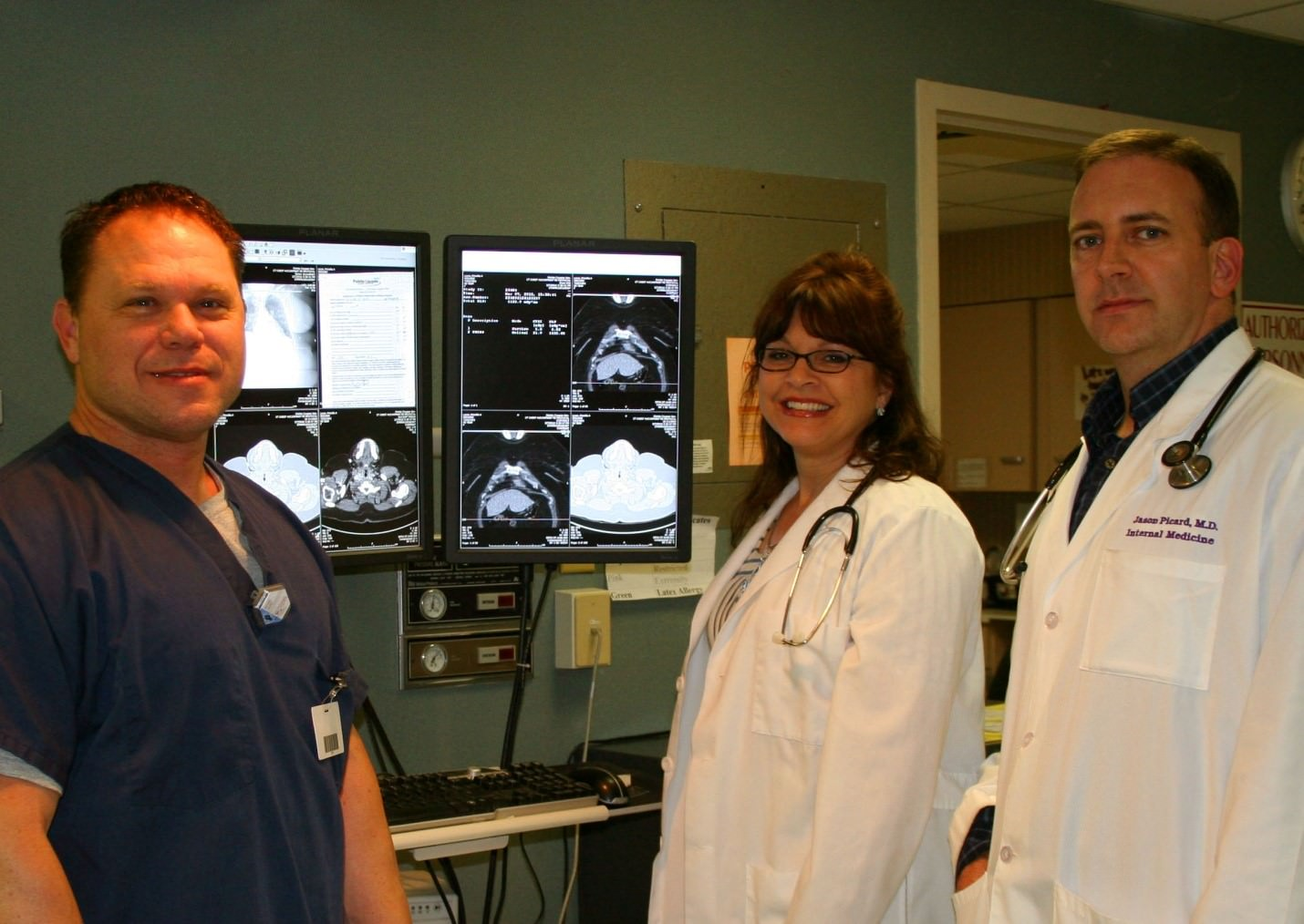 Mike Causey, RT(R), Michelle Carley, MD, ER Physician, and Jason Picard, MD, FACP, view radiologic images via (PACS) Picture Archiving Communication System.