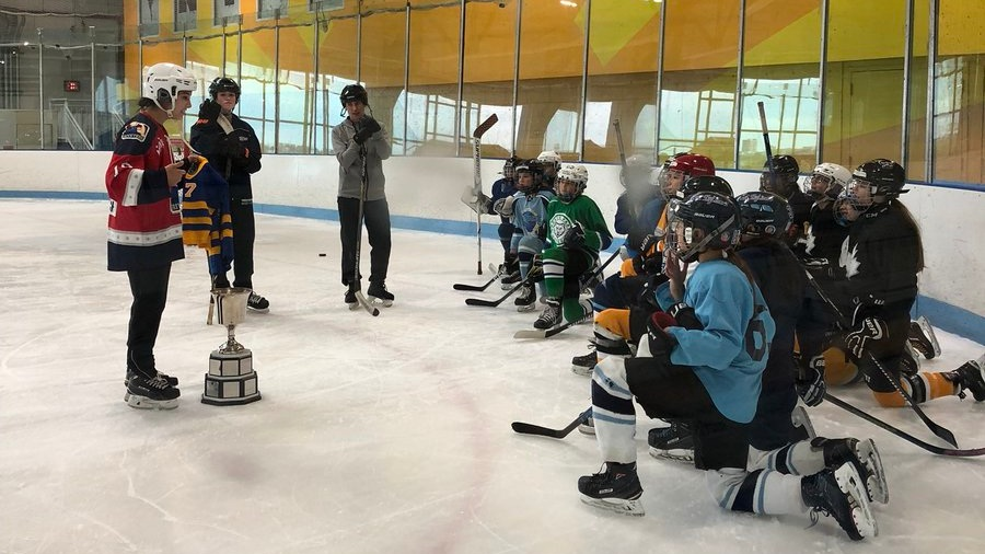 """""""Back when that jersey was a dress on me, I was the only girl on my team. Yesterday, I got to show the cup to the first ever girls' Cyclones team. Way cool."""""""