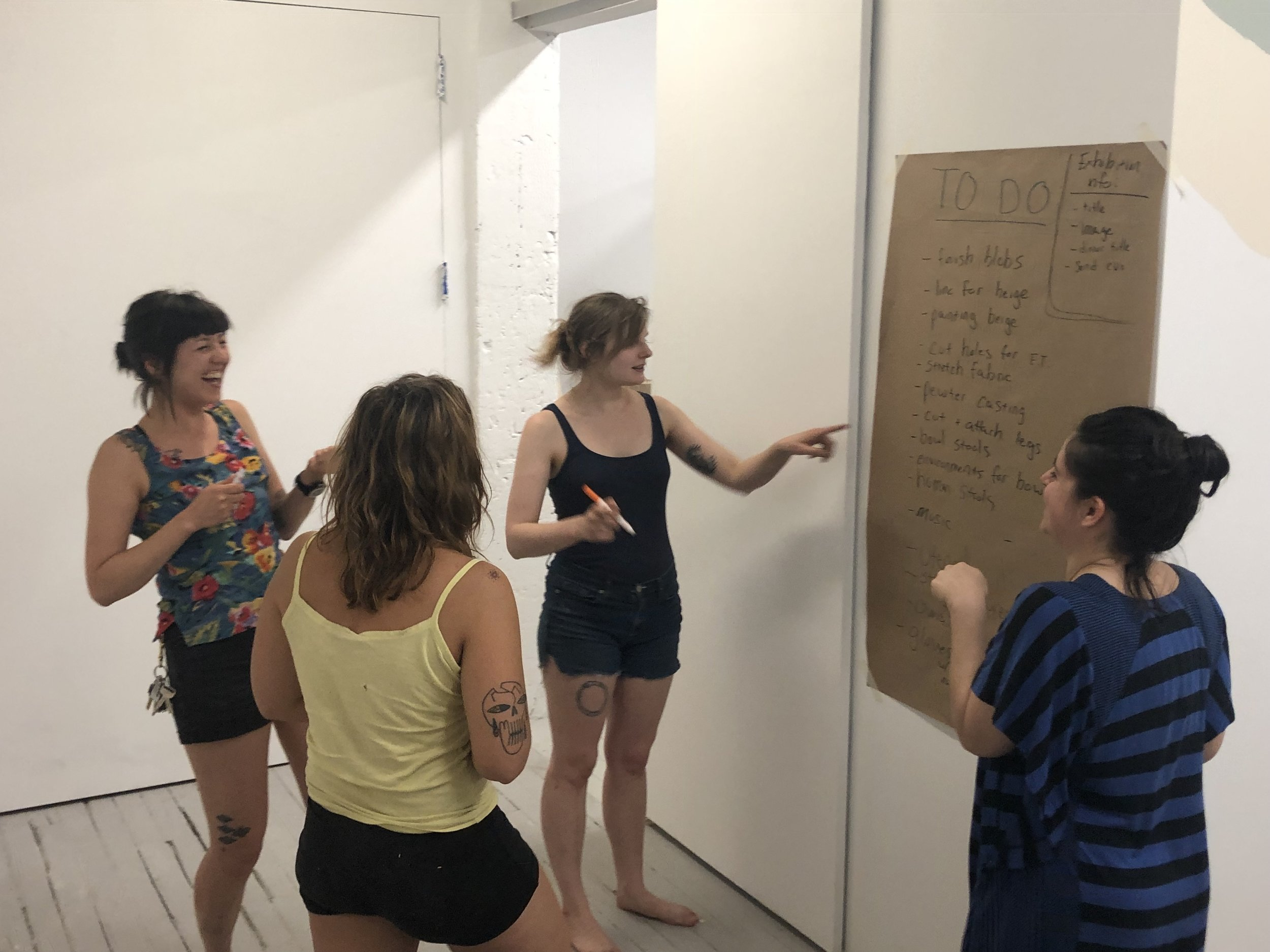 Annas' spring cohort of residents working together on their exhibition  a yolk, suspended .