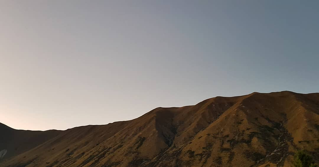 The view of the Ben Ohau range at dusk from the lounge and both bedrooms