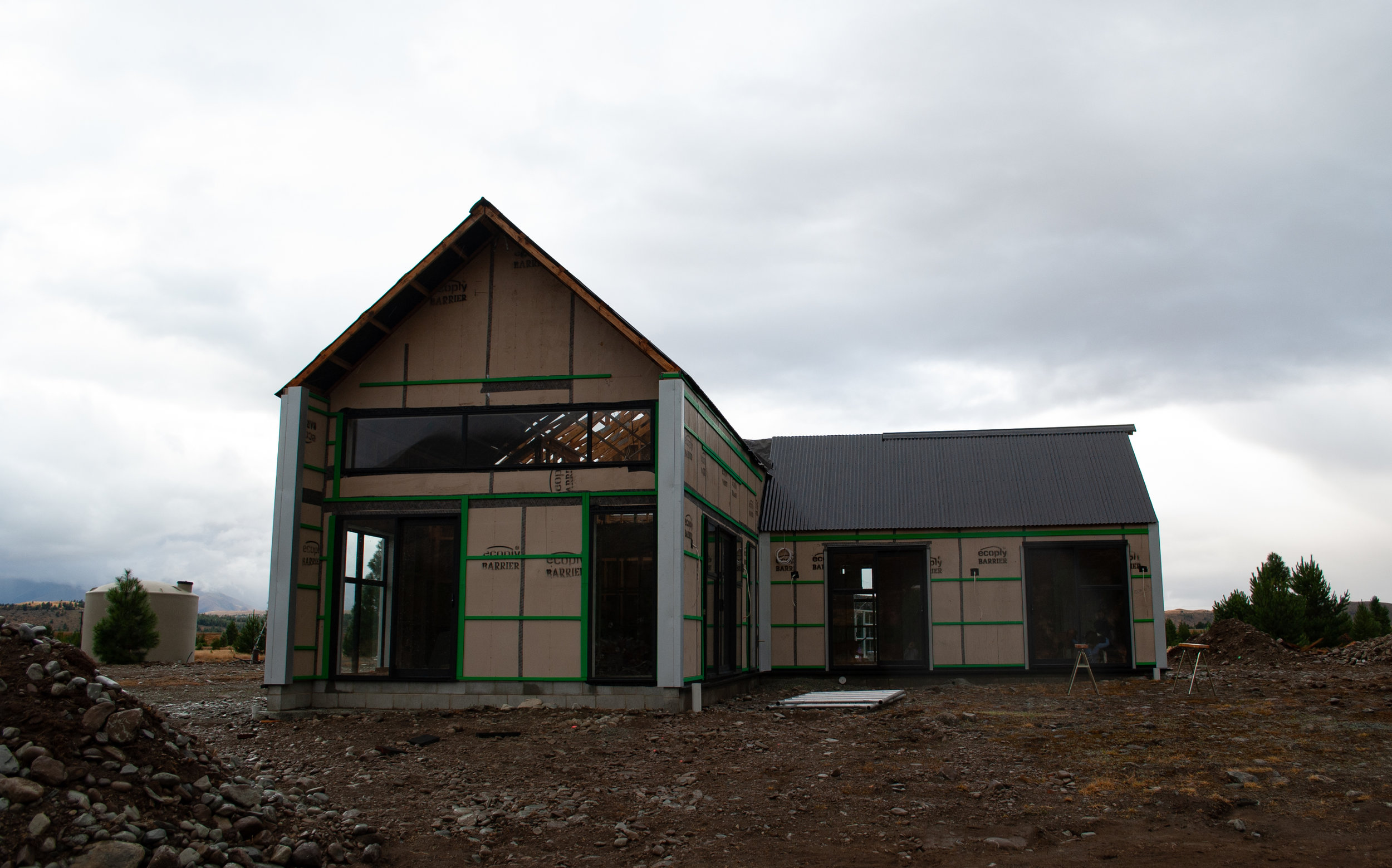 Taken on the 24th of February. The insulation is in and this week the walls go up and gib stopping begins. The whole house has now been wired and plumbed, the septic and water tanks have been installed. The internal doors have arrived and the kitchen is booked for installation!