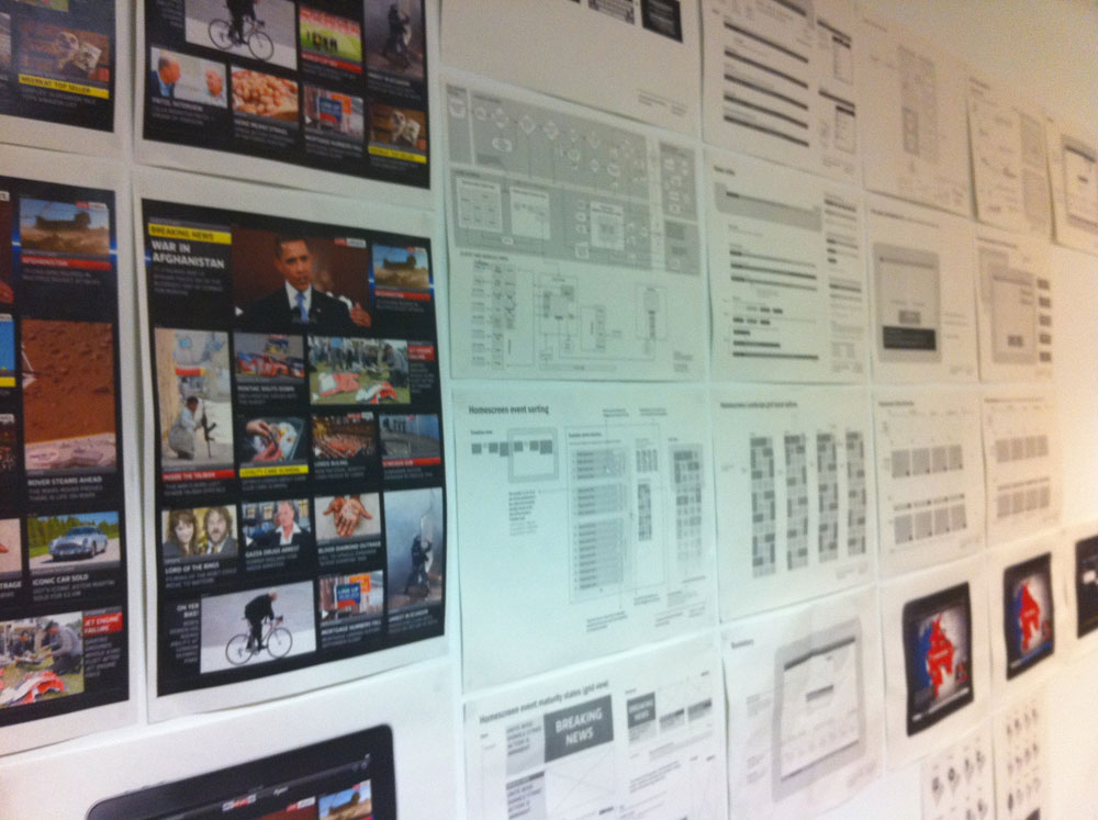 A selection of system diagrams, journeys and UI designs on our war room walls