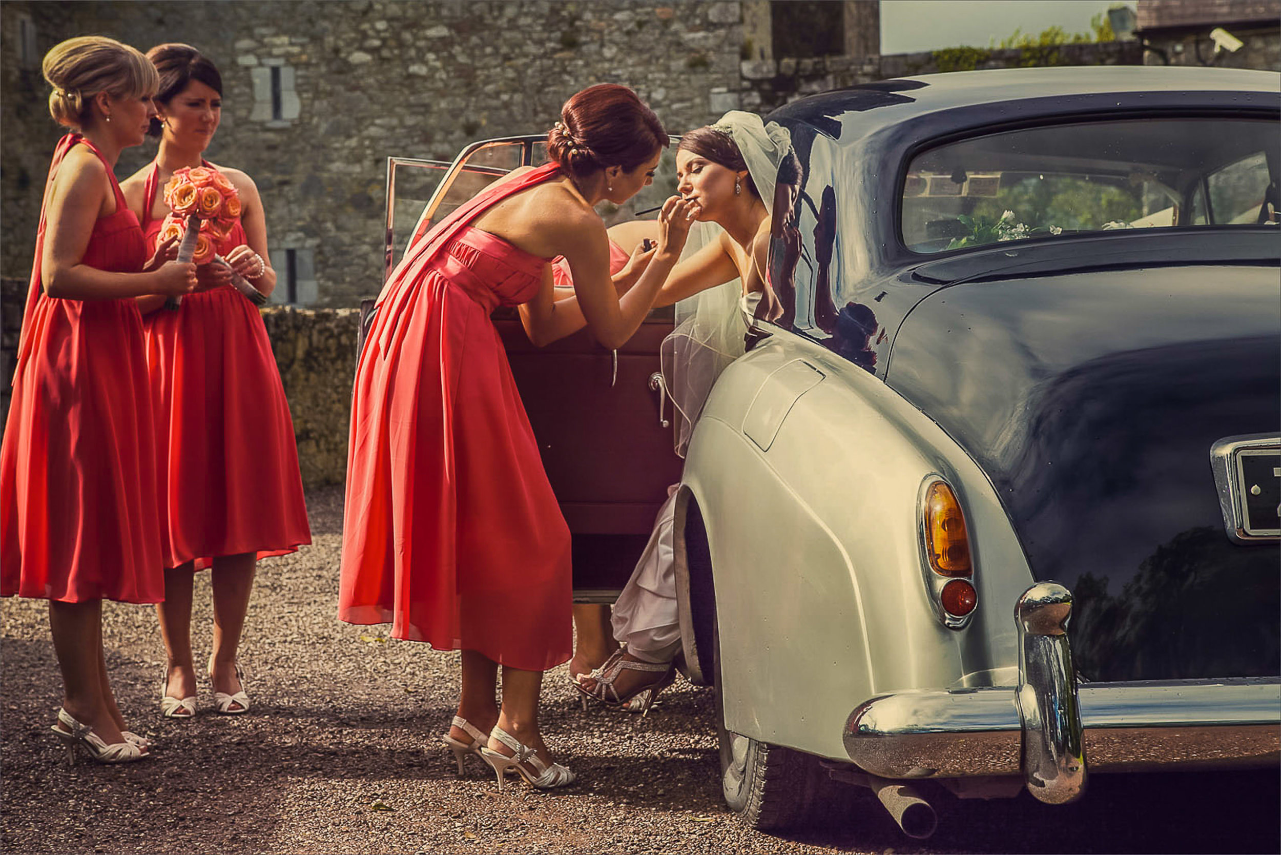 Vintage Wedding Car - Wedding photography in Cork Ireland by David Casey. Bride in white wedding dress with bridesmaids in colourful bridesmaids dresses