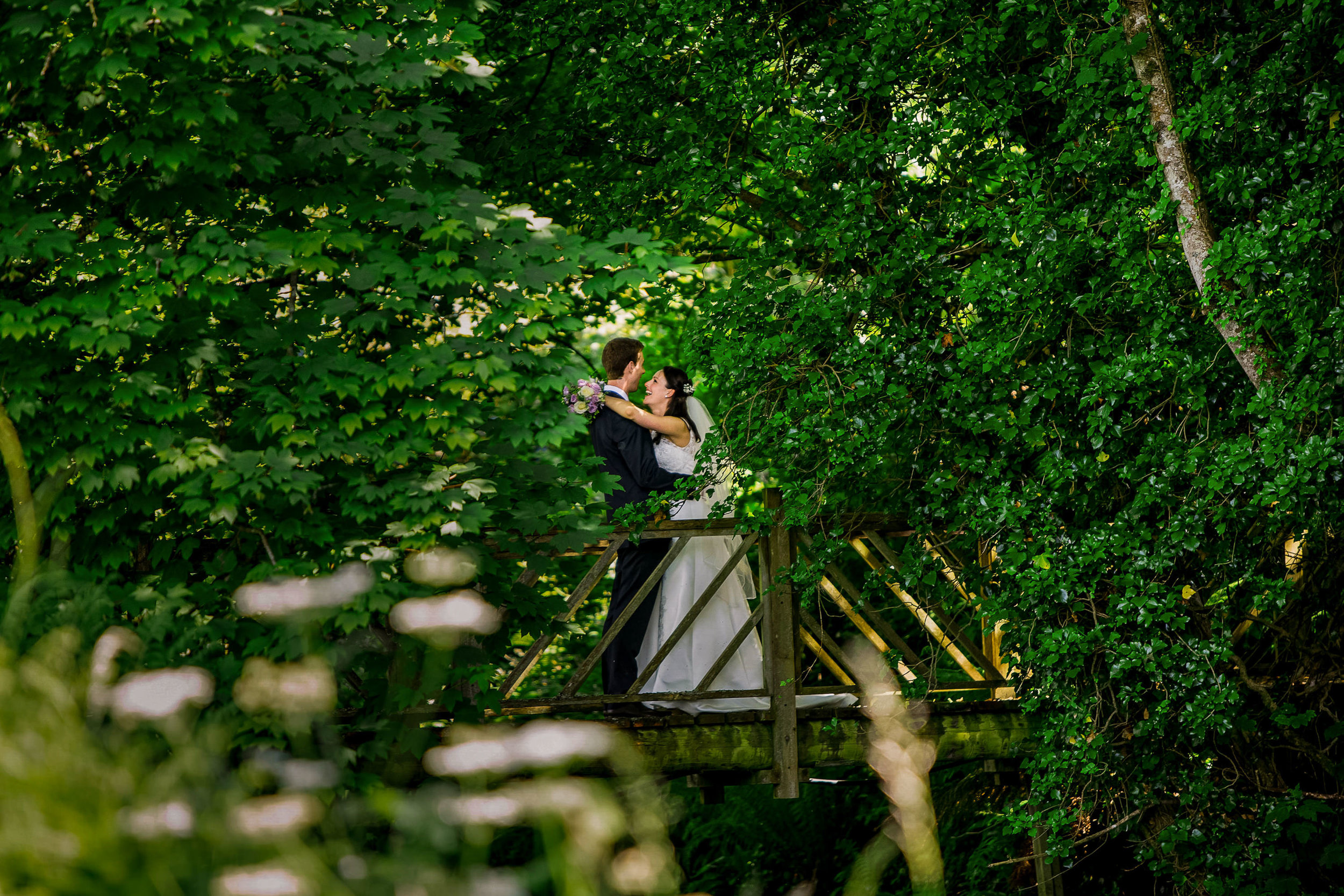 Glebe Gardens Wedding Photography by Casey Photography. Baltimore West Cork. Bride and Groom on bridge.