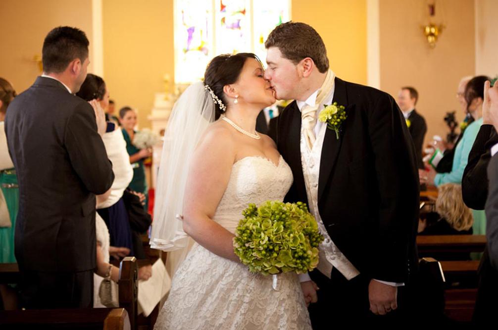 22_Bride_and_groom_walk_down_thw_aisle.jpg