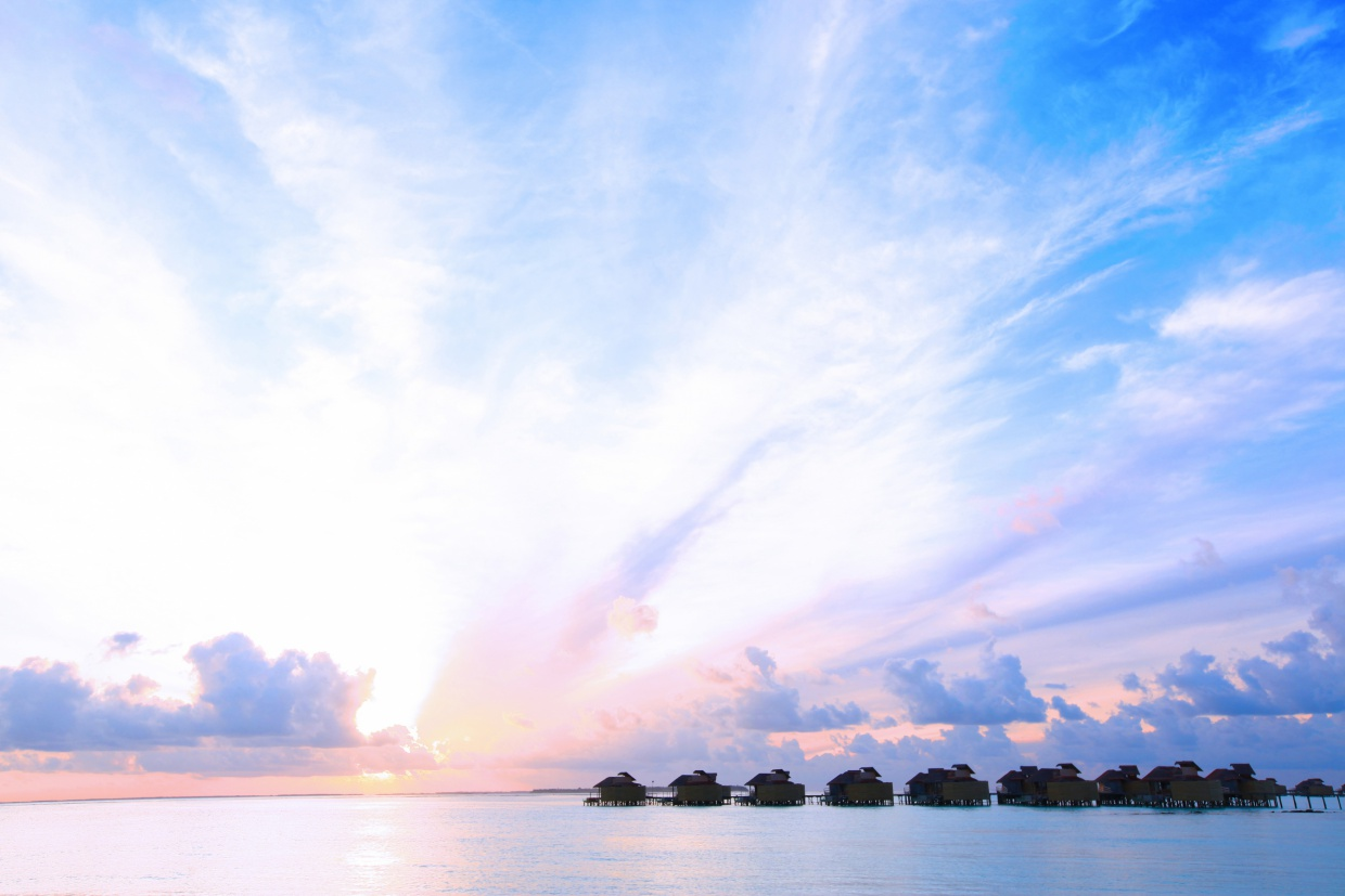 Six_Senses_Laamu_Water_Villa_Sunset_Wave_Collective.jpg