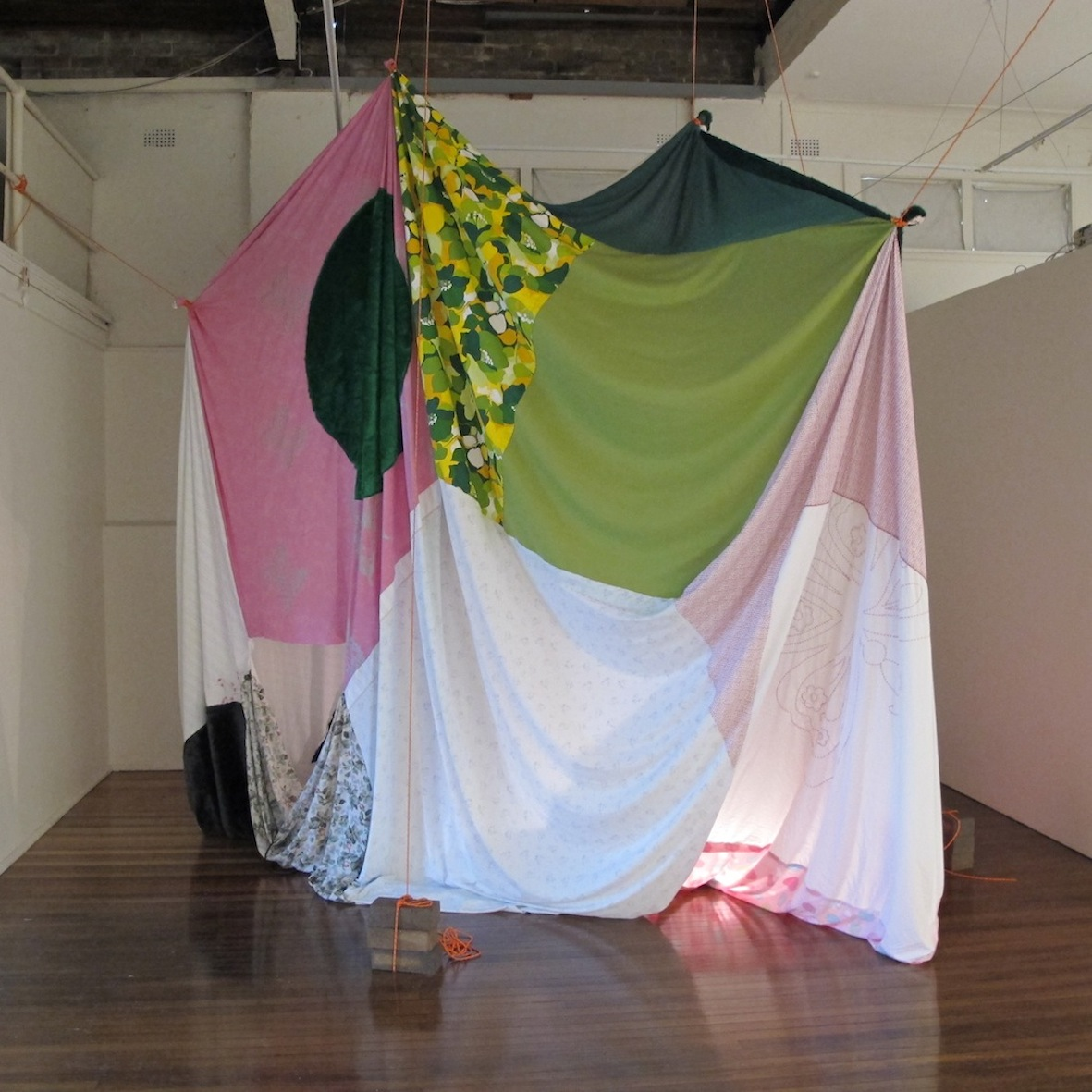 Memory Tent    2013  Bedsheets, doona covers, faux fur, crochet tablecloth, rope, bricks and lamp  300 x 300 x 300 cm