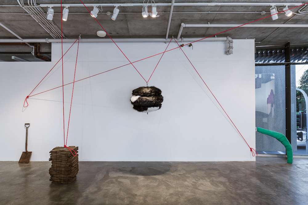 Forward Planning   2016  Michelle Cawthorn and Peter Sharp  Faux fur, MDF, threaded rod, hex nut, eye nut, rope, pulleys, snap hooks, eye plates, cleat, poly/cotton thread, fill, hand hewn eucalypt timbers, acrylic paint and found stool  Dimensions variable  Image credit: Document Photography