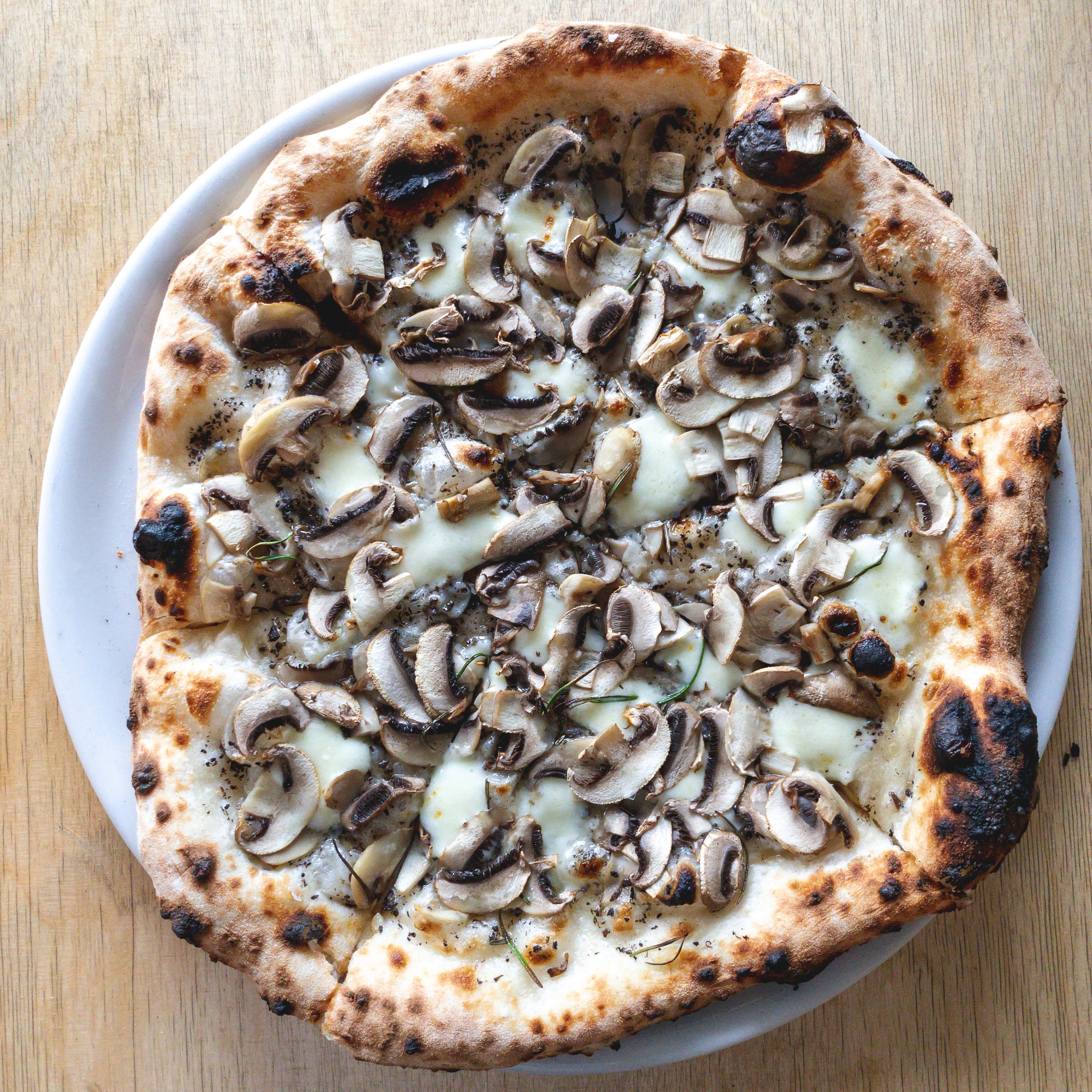 Wild Mushroom: truffle oil, mushrooms, rosemary, sea salt, mozzarella. (v)