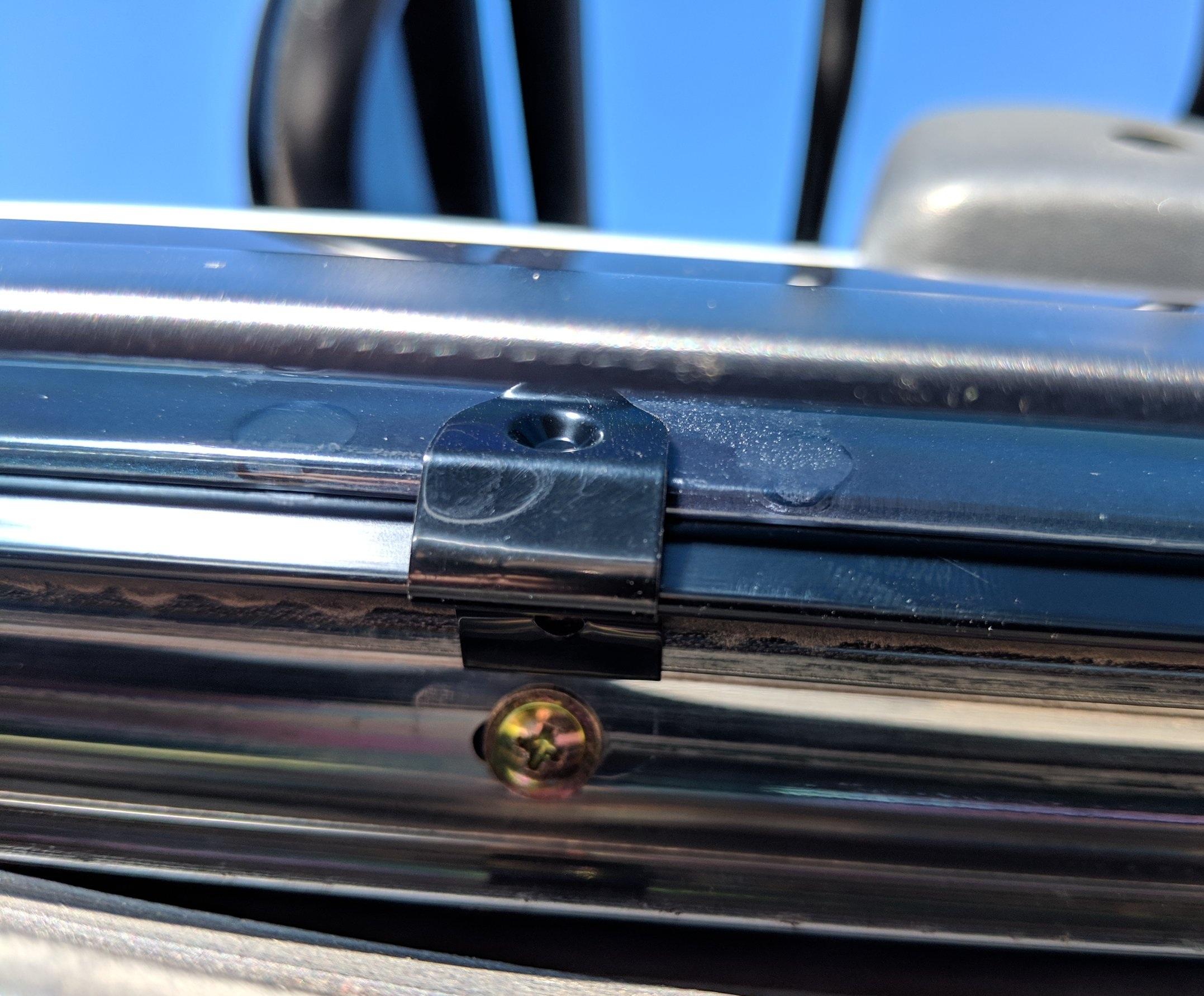 Rear clip in place located near a screw.
