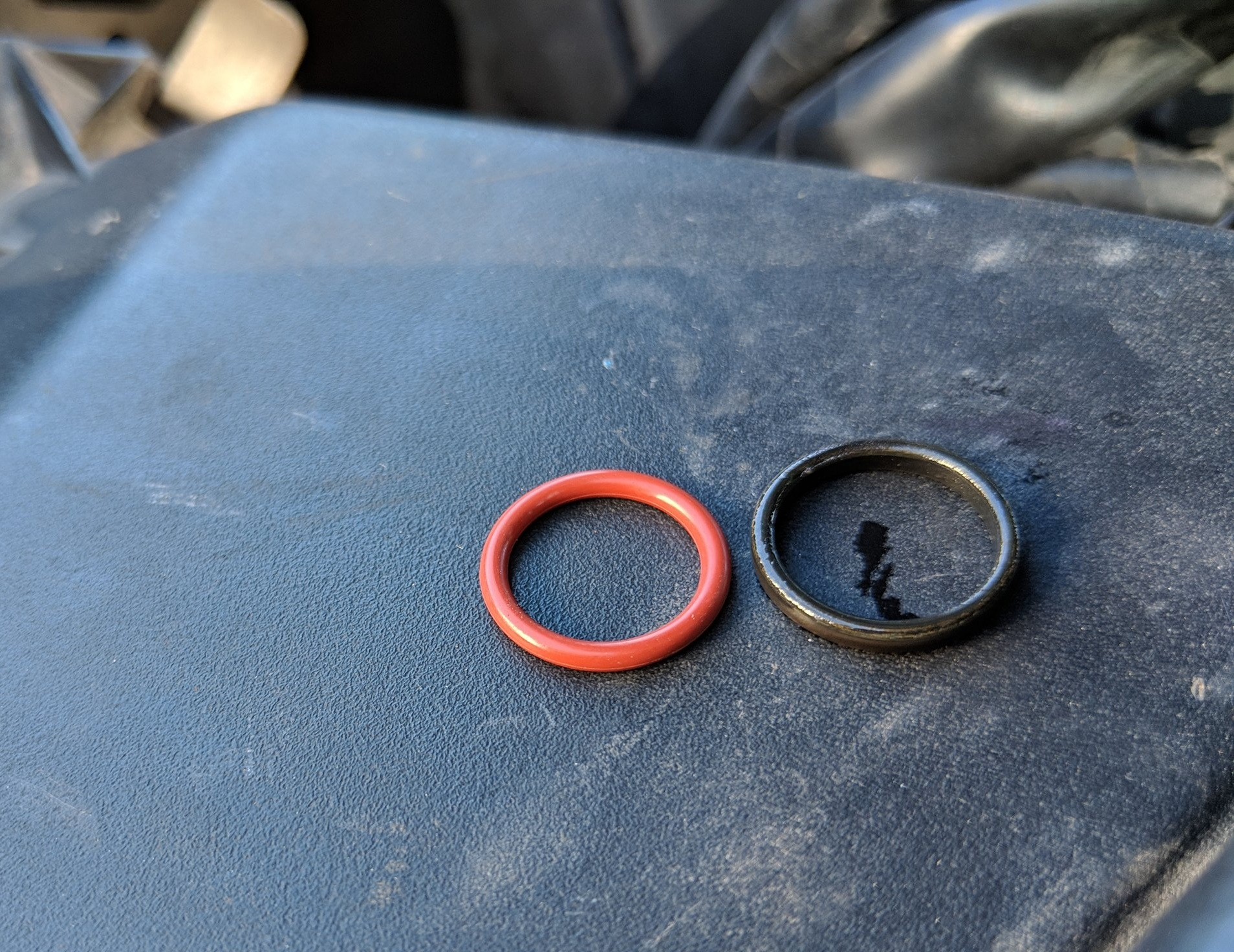 Left :  New Subaru O-ring  Right: Old O-ring You can see how much smaller and thinner the outgoing O-ring is.