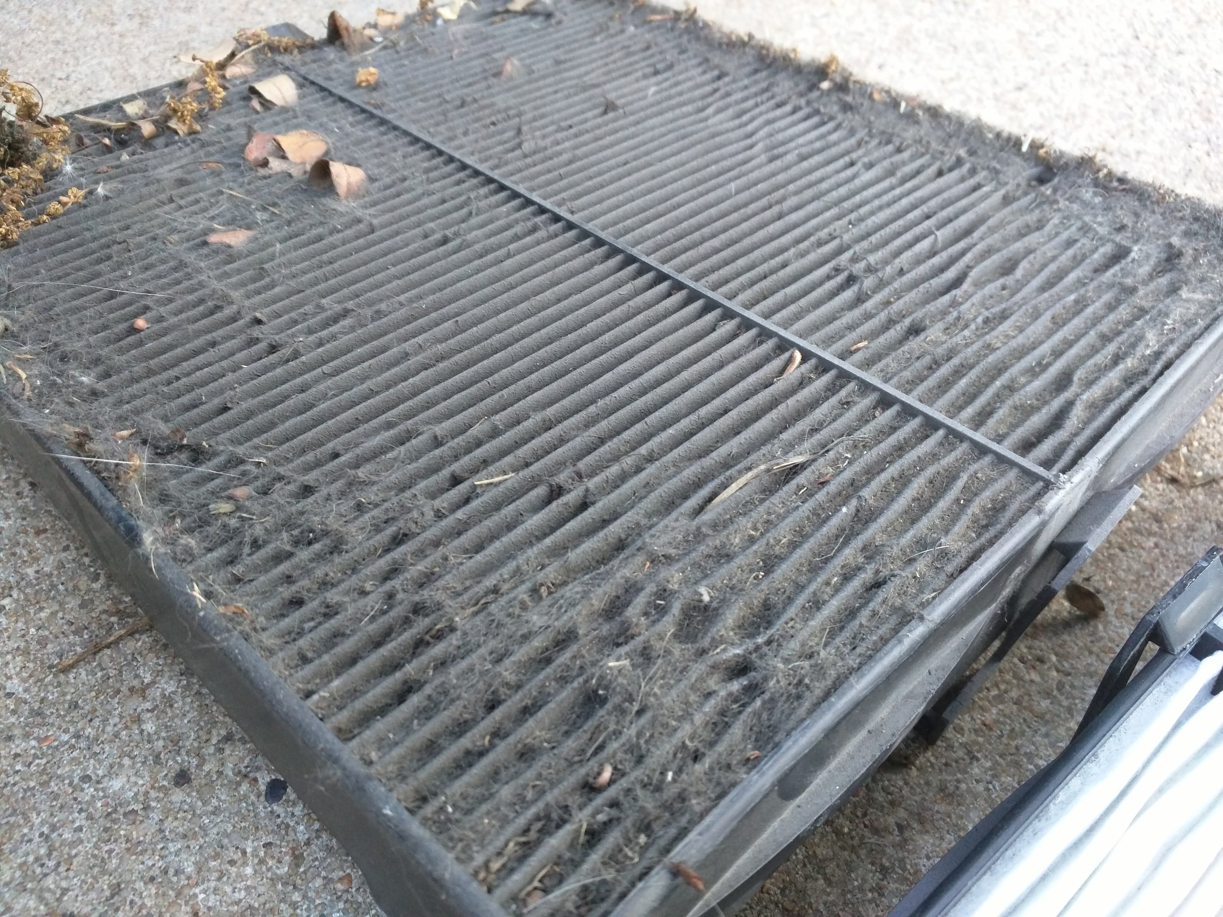 This is my ridiculous cabin filter from the first week of owning my Forester. I am 99% sure it was never changed over the 196k miles before I bought the car.