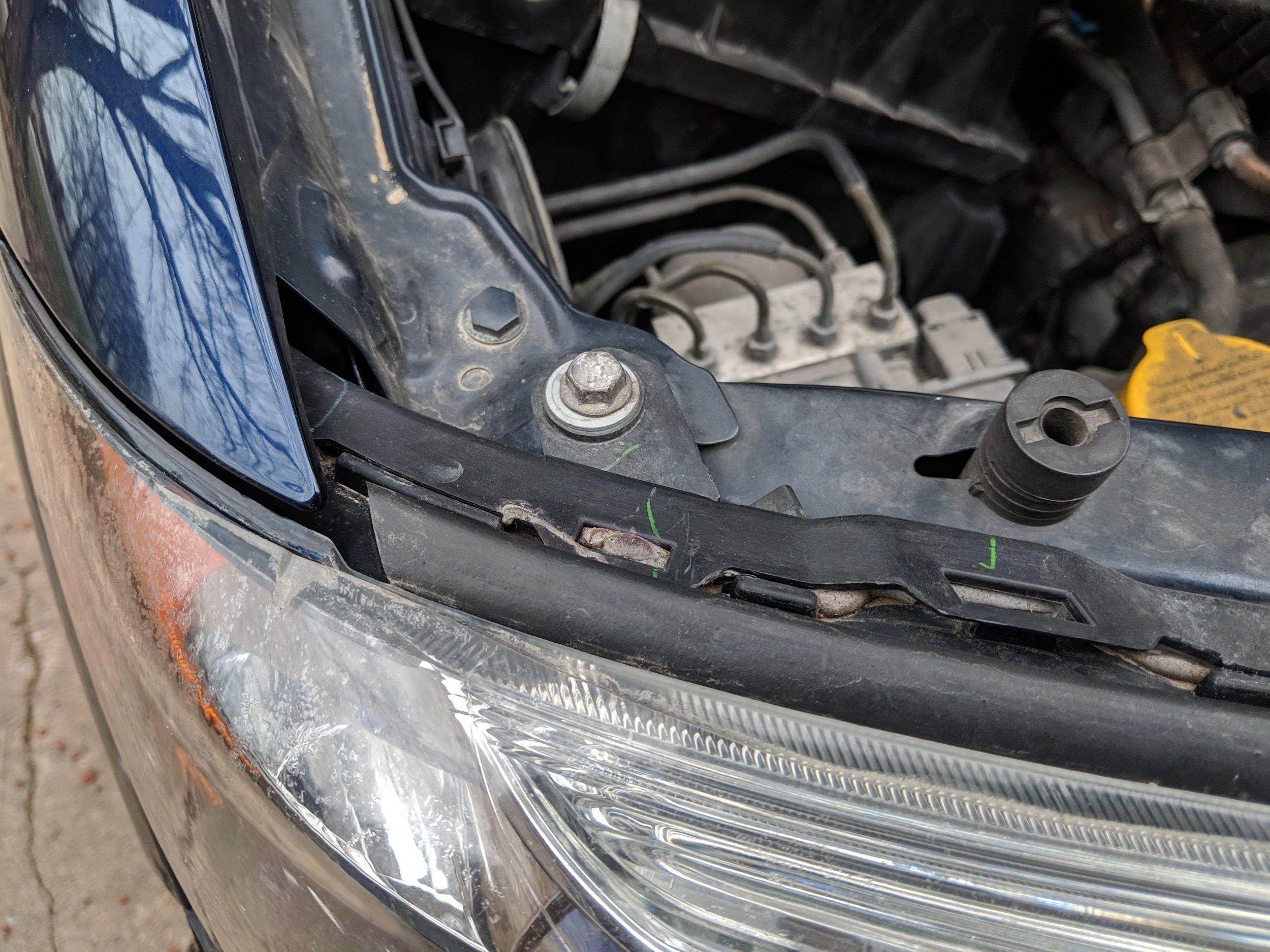 Upper bolt location under the hood.
