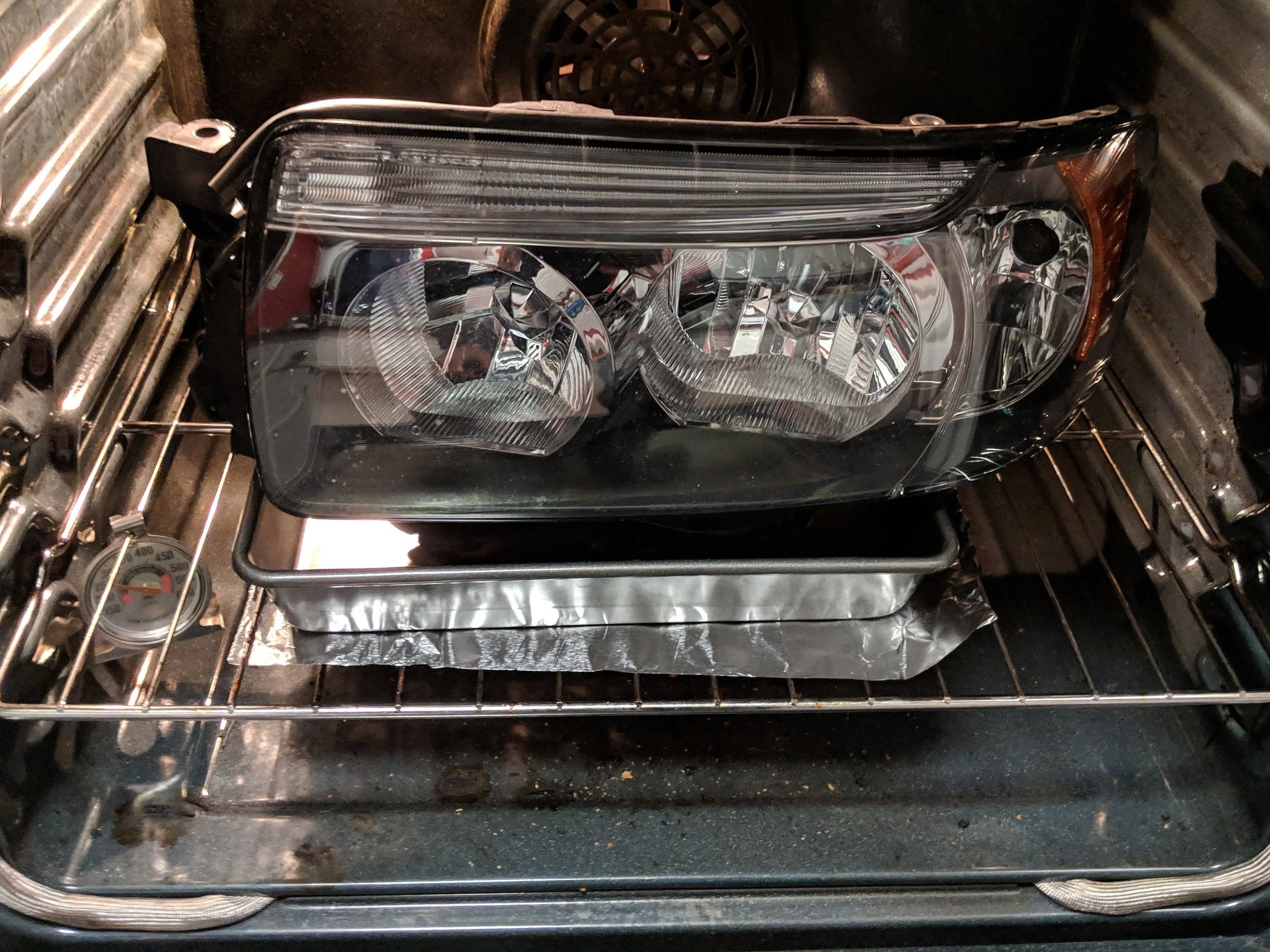 Back into the oven to ready the butyl for resealing the headlight.