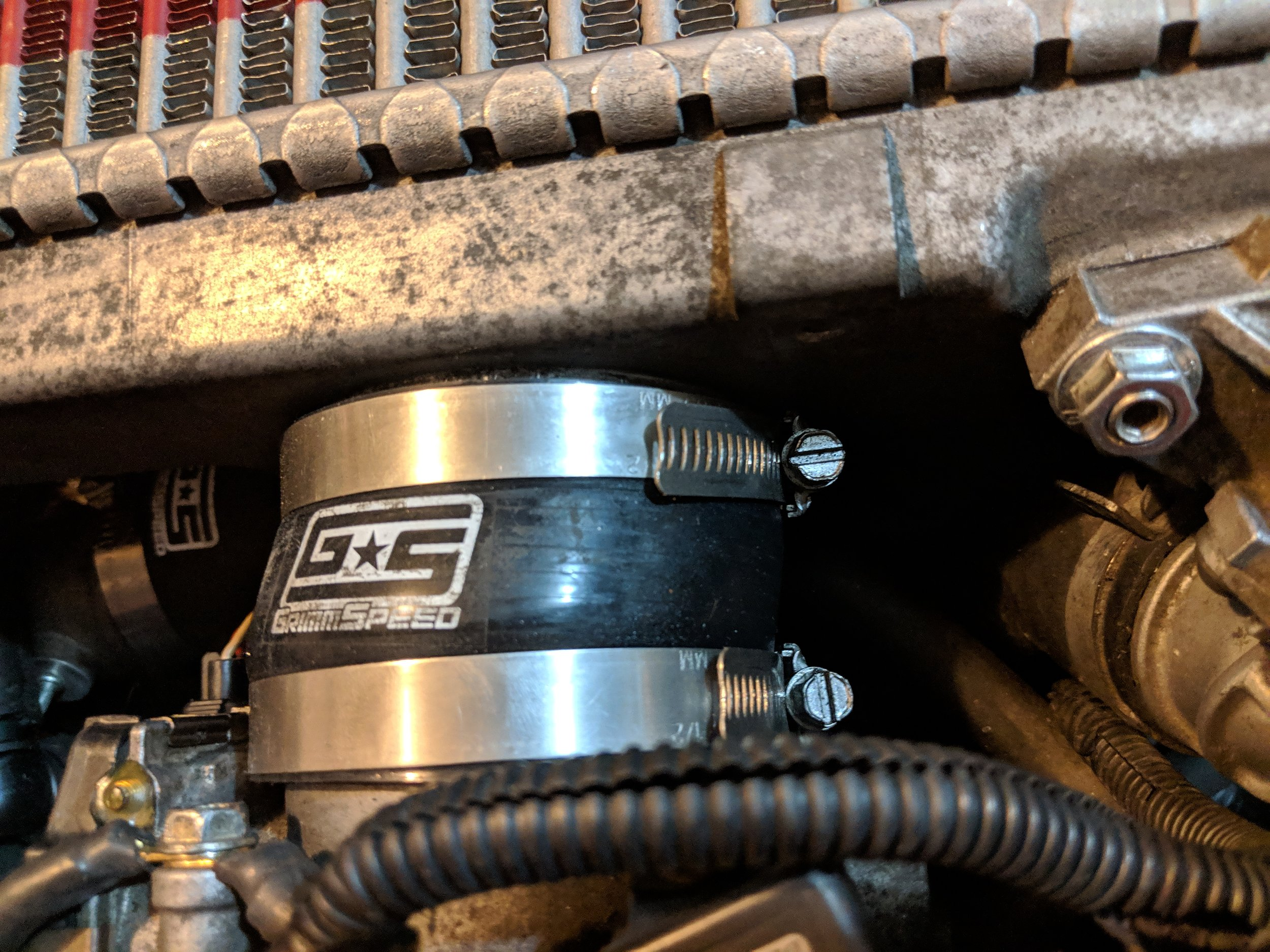 Preferred placement of the intercooler to throttle body couple. Driver's side tucked down by the BPV(Bypass valve)