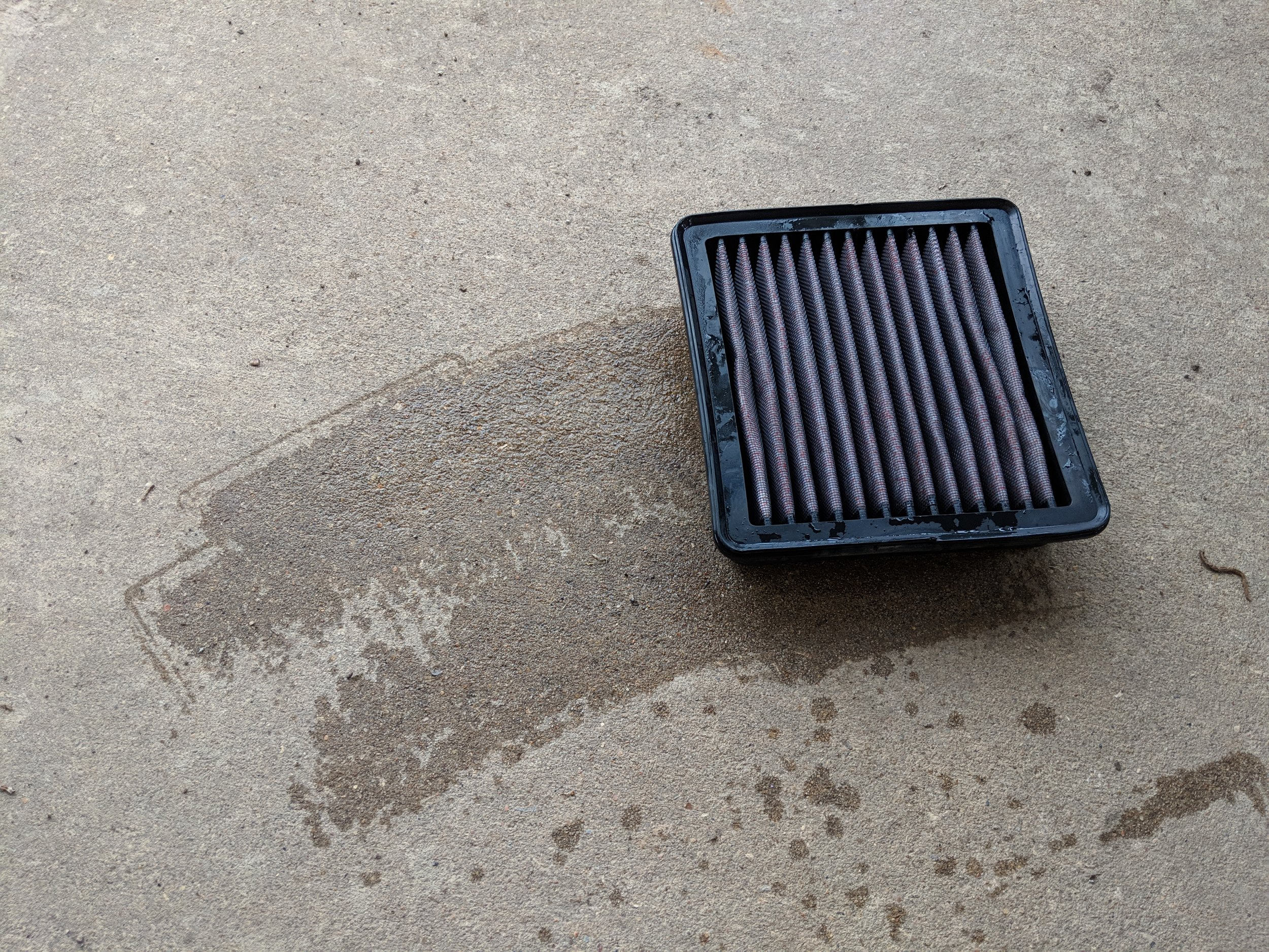 Slapping the filter onto the ground will help the quicken up the drying process. While knocking the loosened debris out.