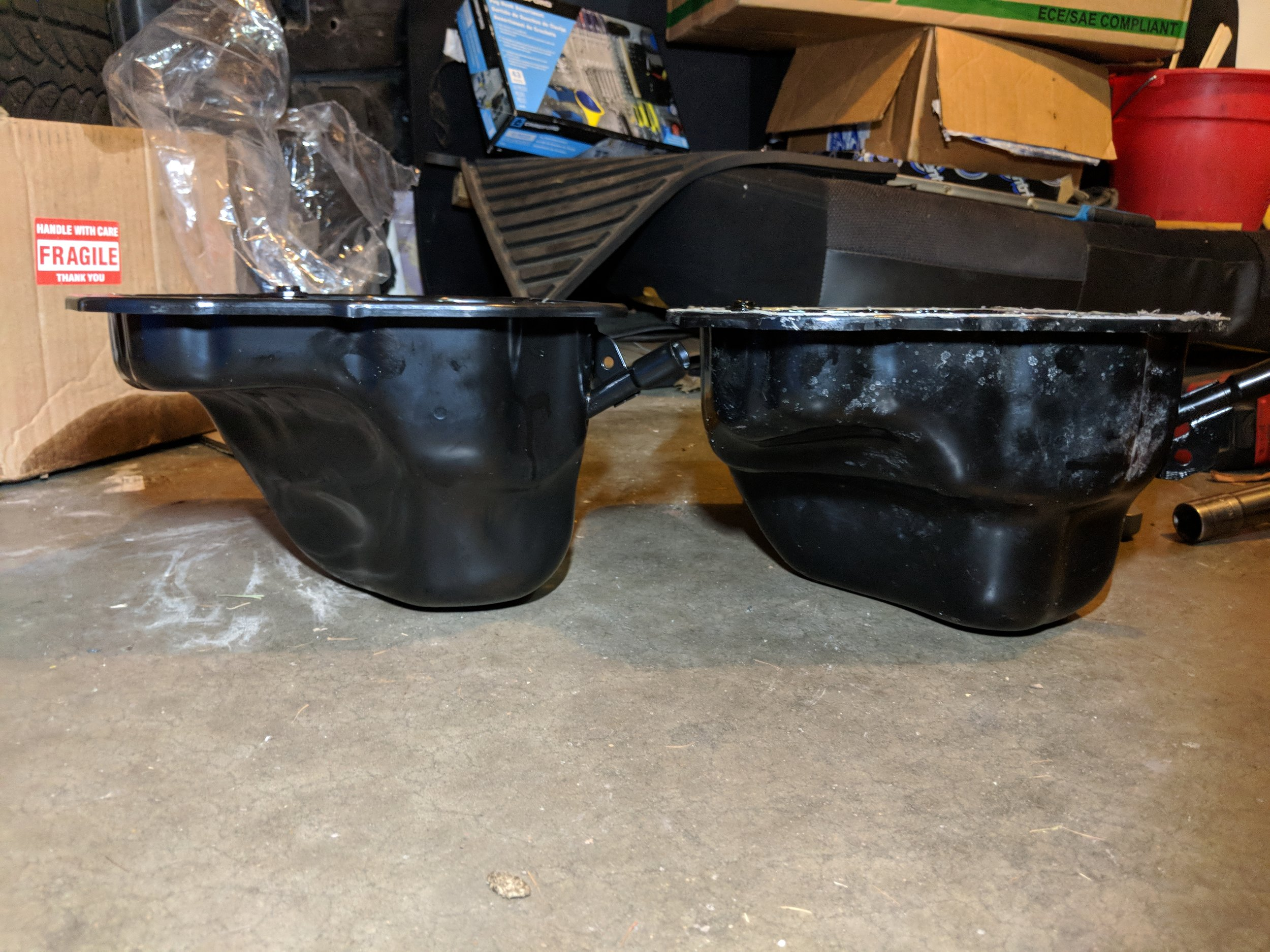 06+ STI oil pan on the left and 04-05 STi pan on the right. The lower protrusion on the left side cause the MAPerformance header to be unable to be fitted.