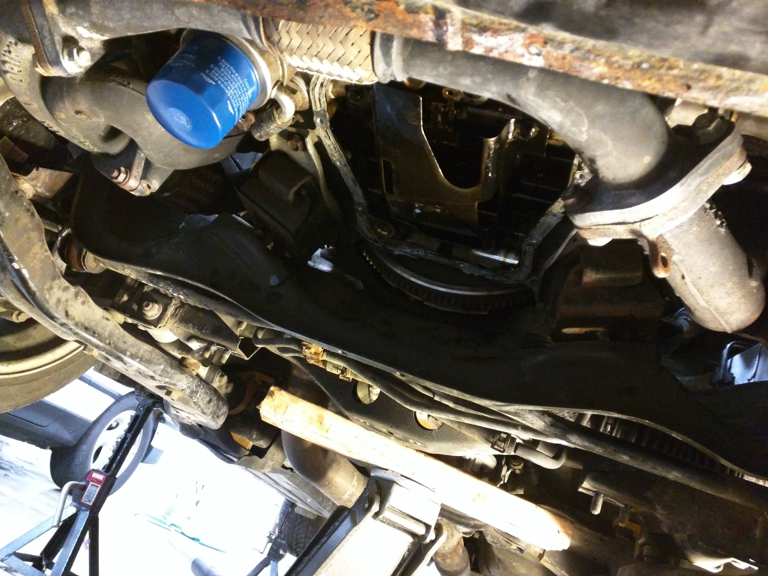 Exhaust manifold on, there is plenty of room to get these out.