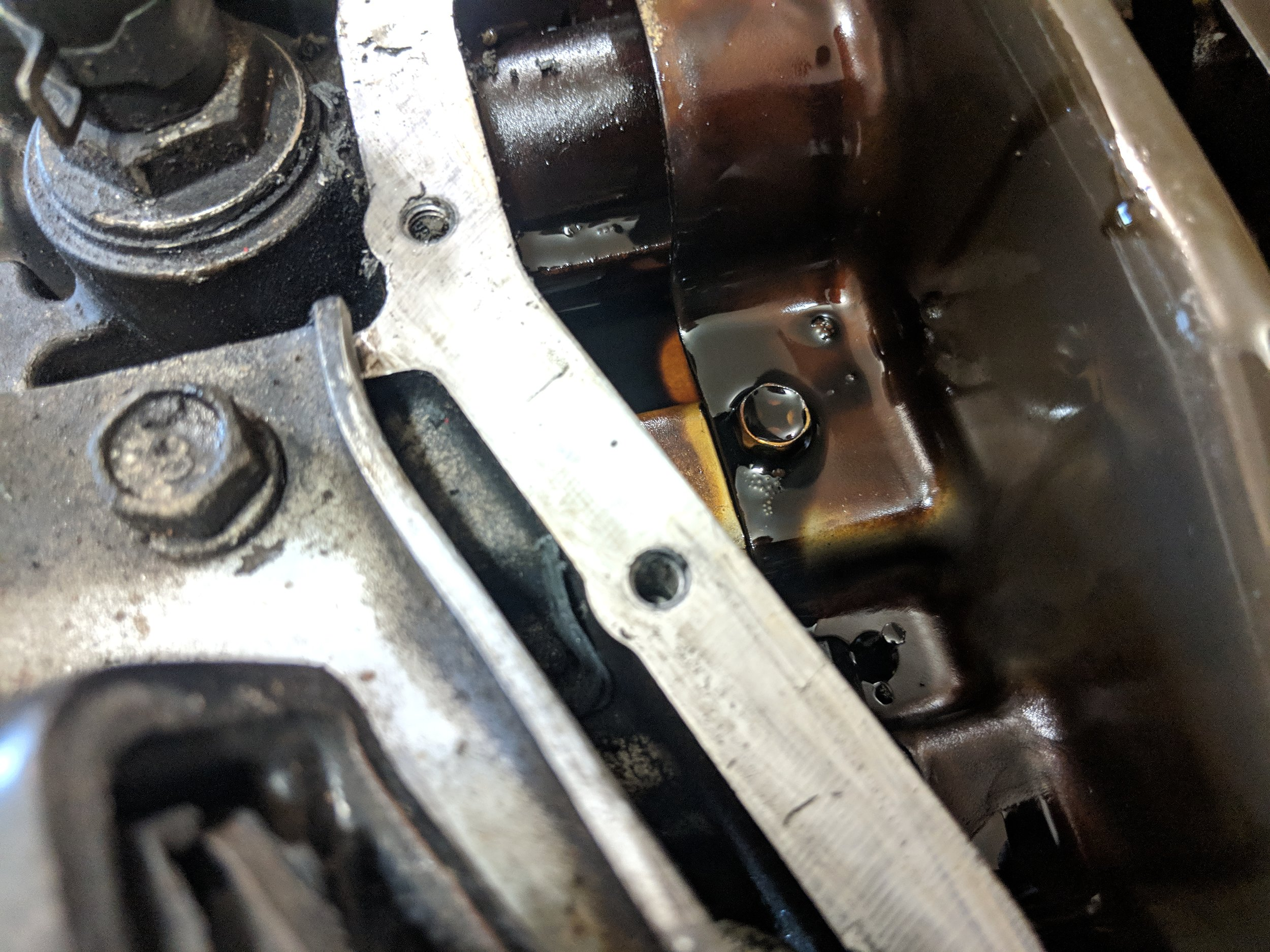 Cleaning off the gasket mating surface, while being careful to keep silicone out of the engine.