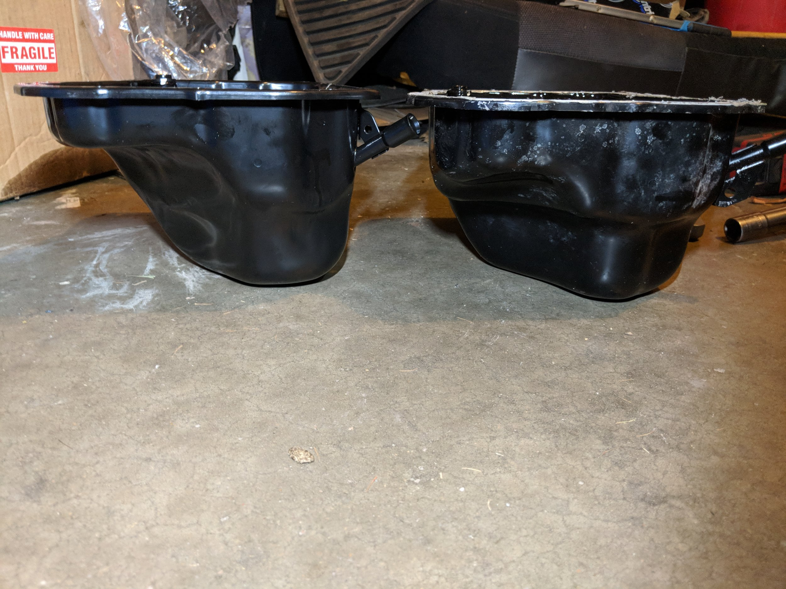 04-05 STI and FXT oil pan on the right. Updated design on the left  06+ STi oil pan.  Some headers have fitment issues with the old style pan and its larger design.