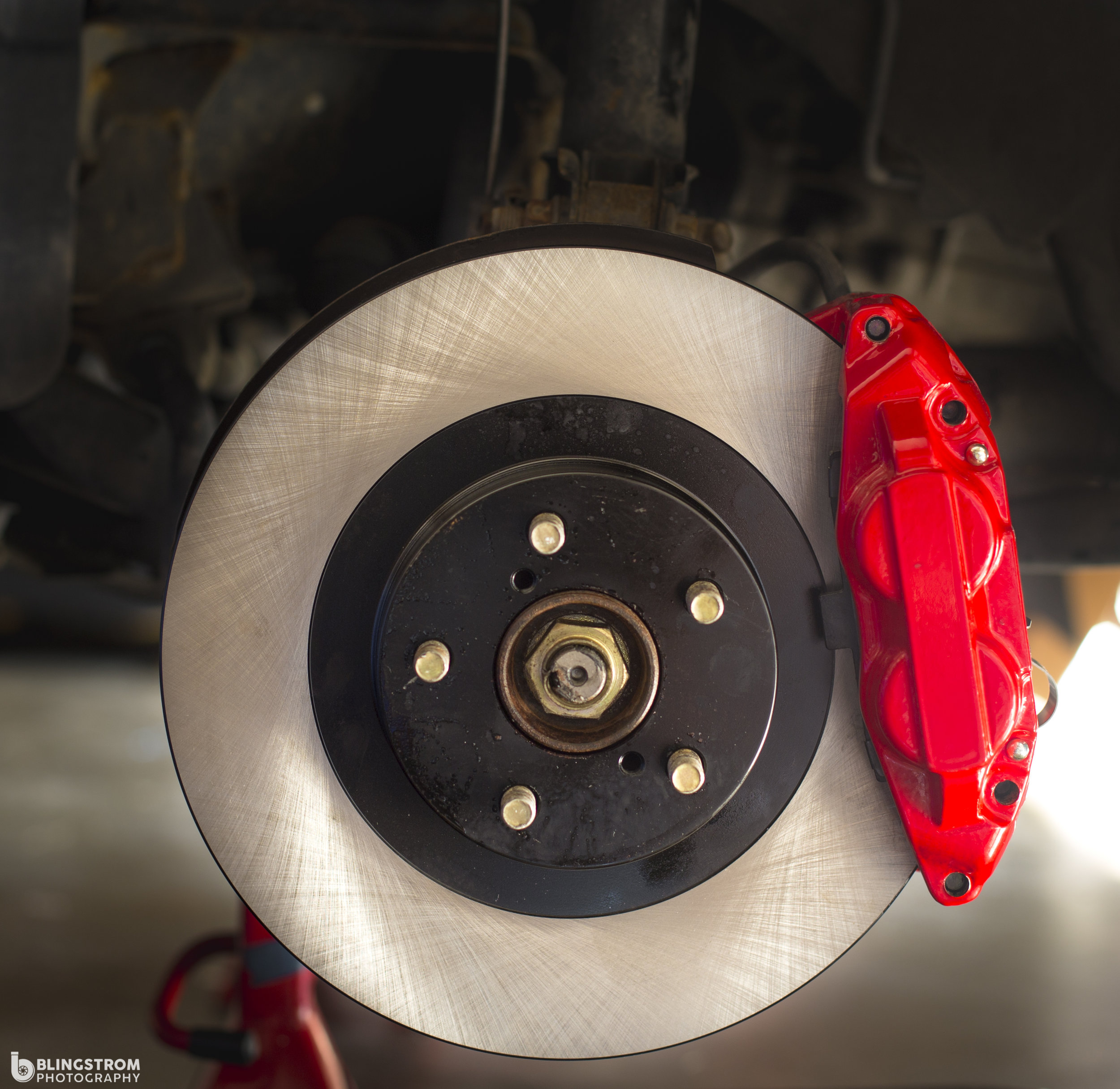 Shiny and new! This is the moment you have been waiting for. new rotors and caliper making their home.