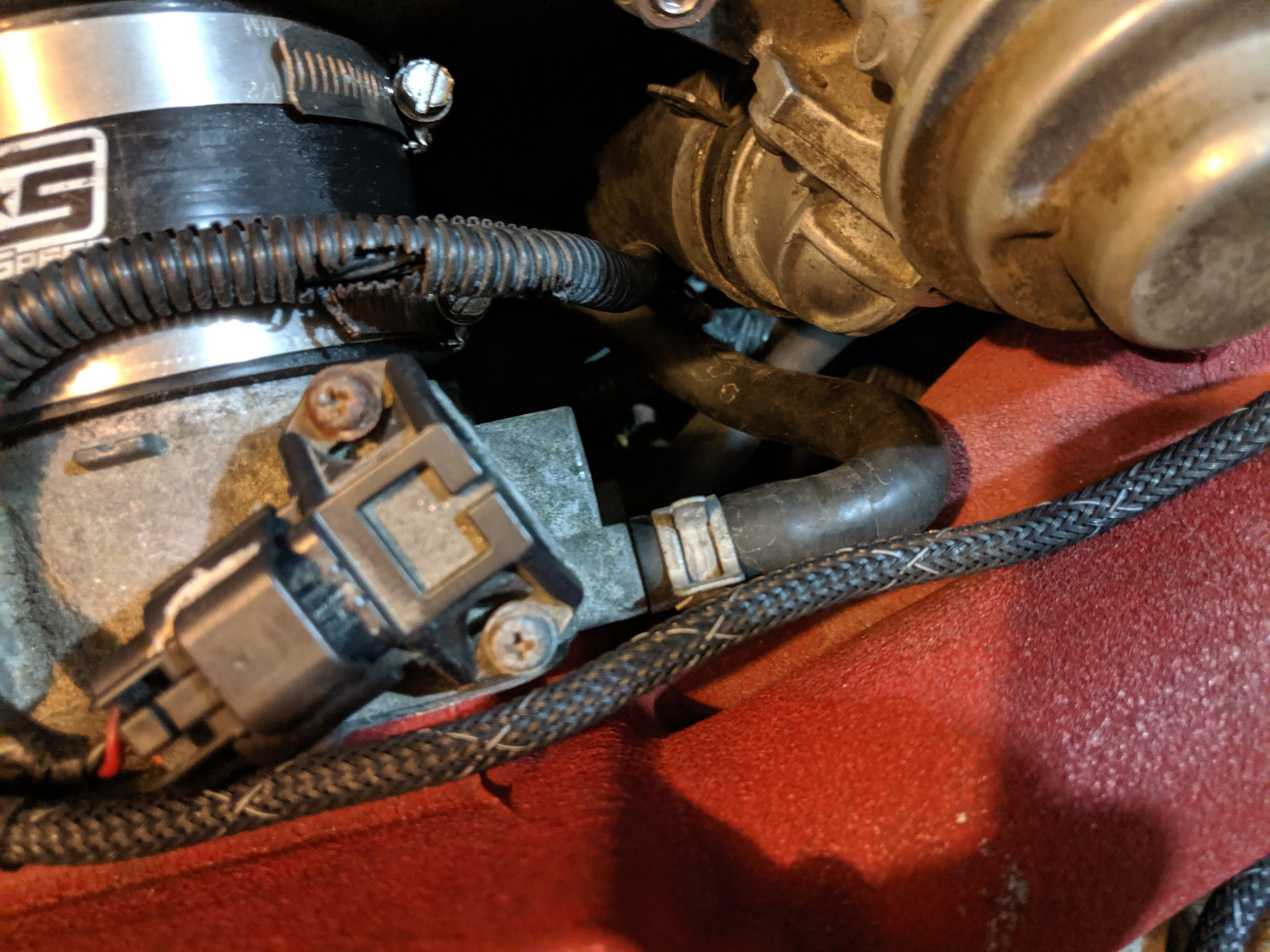 This is the upper coolant line and not seen but right below it. The other line attaches, remove them both.