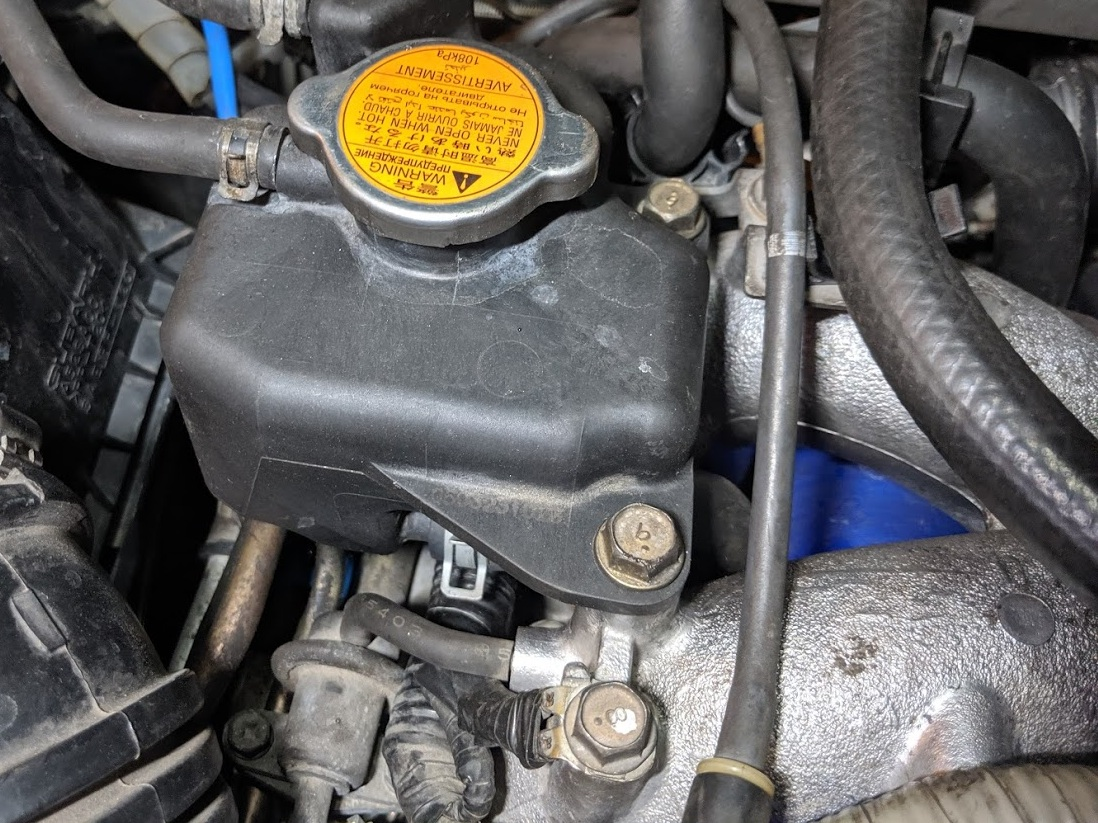 Remove the two bolts on the manifold. This is a great time to remove the rubber line that ties to the boost controller Then remove the clamp you can just see. or you can remove the lower clamp not seen in this photo.