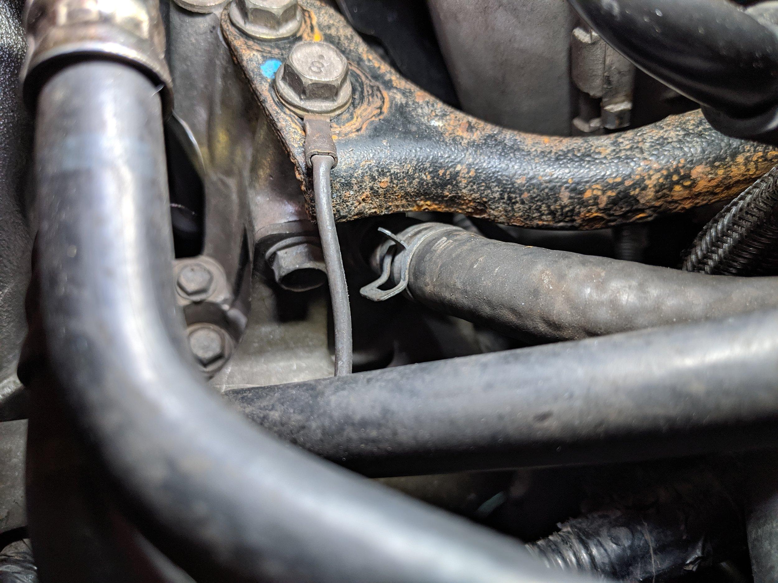 Brake booster hose slightly hidden under the driver's side intercooler bracket.