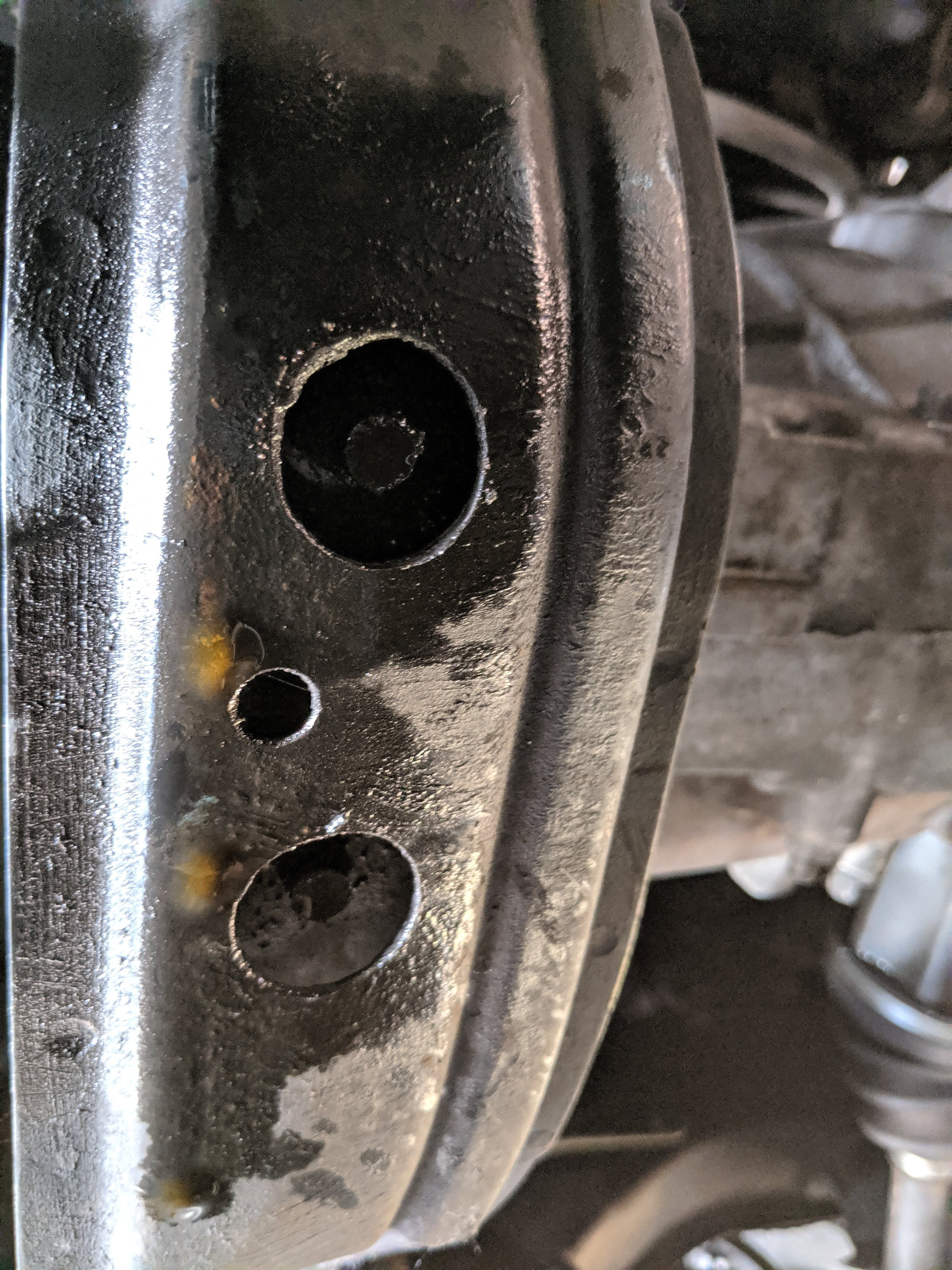 Center bolts that hold the front of the transmission brace together.