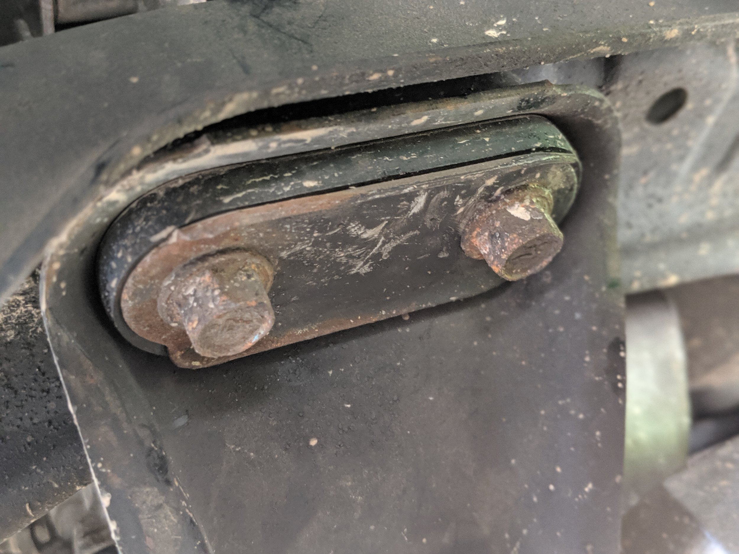 These are the only bolts we need to remove. Located at the rear of the transmission brace.