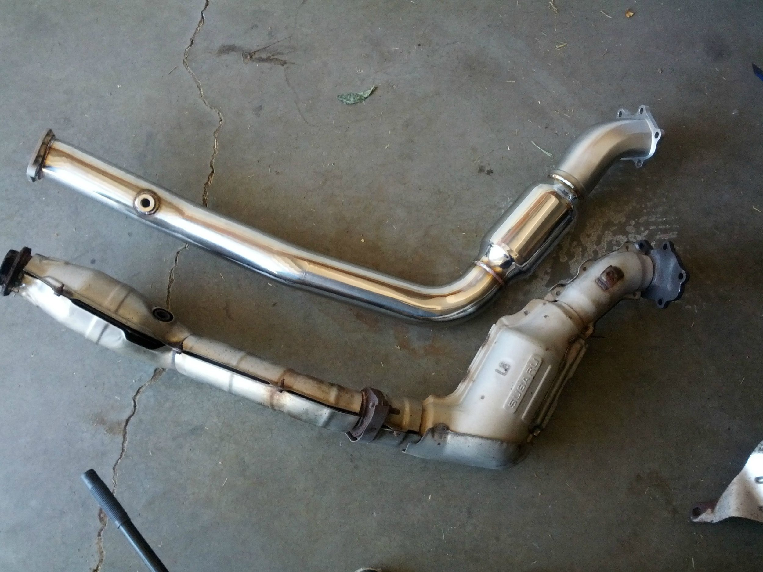 Fancy new downpipe is ready to get put on, but how will you connect your it to your exhaust….