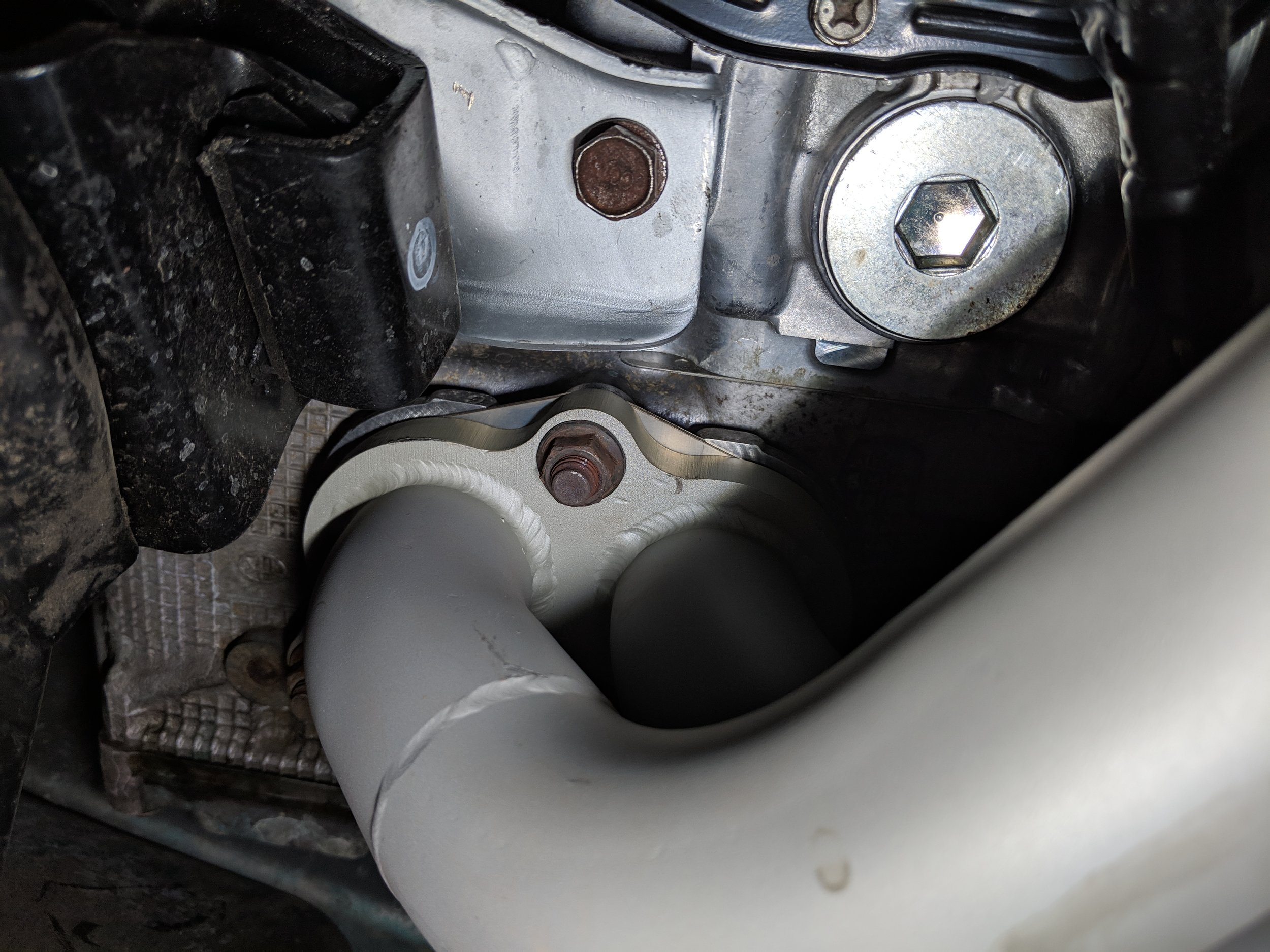 The driver side exhaust manifold nuts are easier to spot. Less wild bends in the exhaust paths.