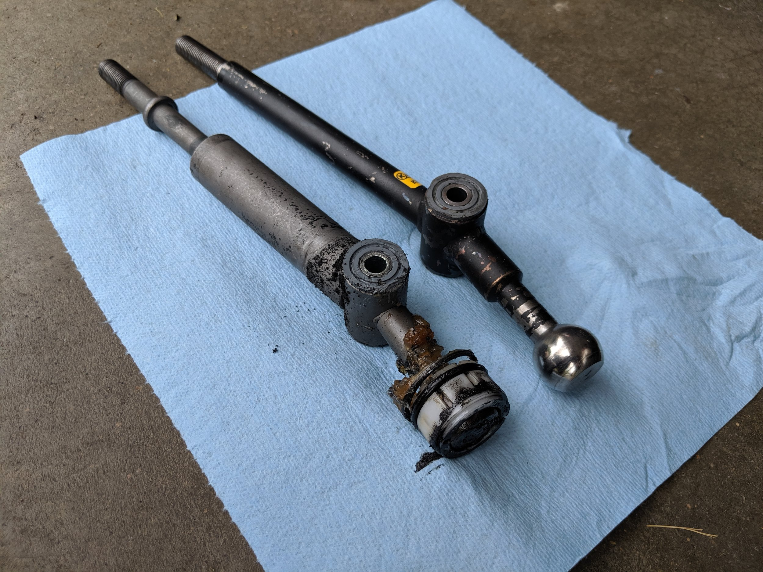 Oem shifter on the left Kartboy on the left. We will need to take off the plastic clip and transfer it ovcer