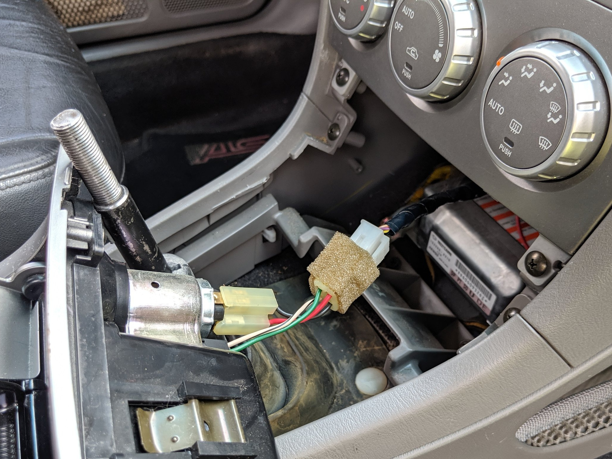 Back in with the cigarette connection. And on then return the shifter trim back on.