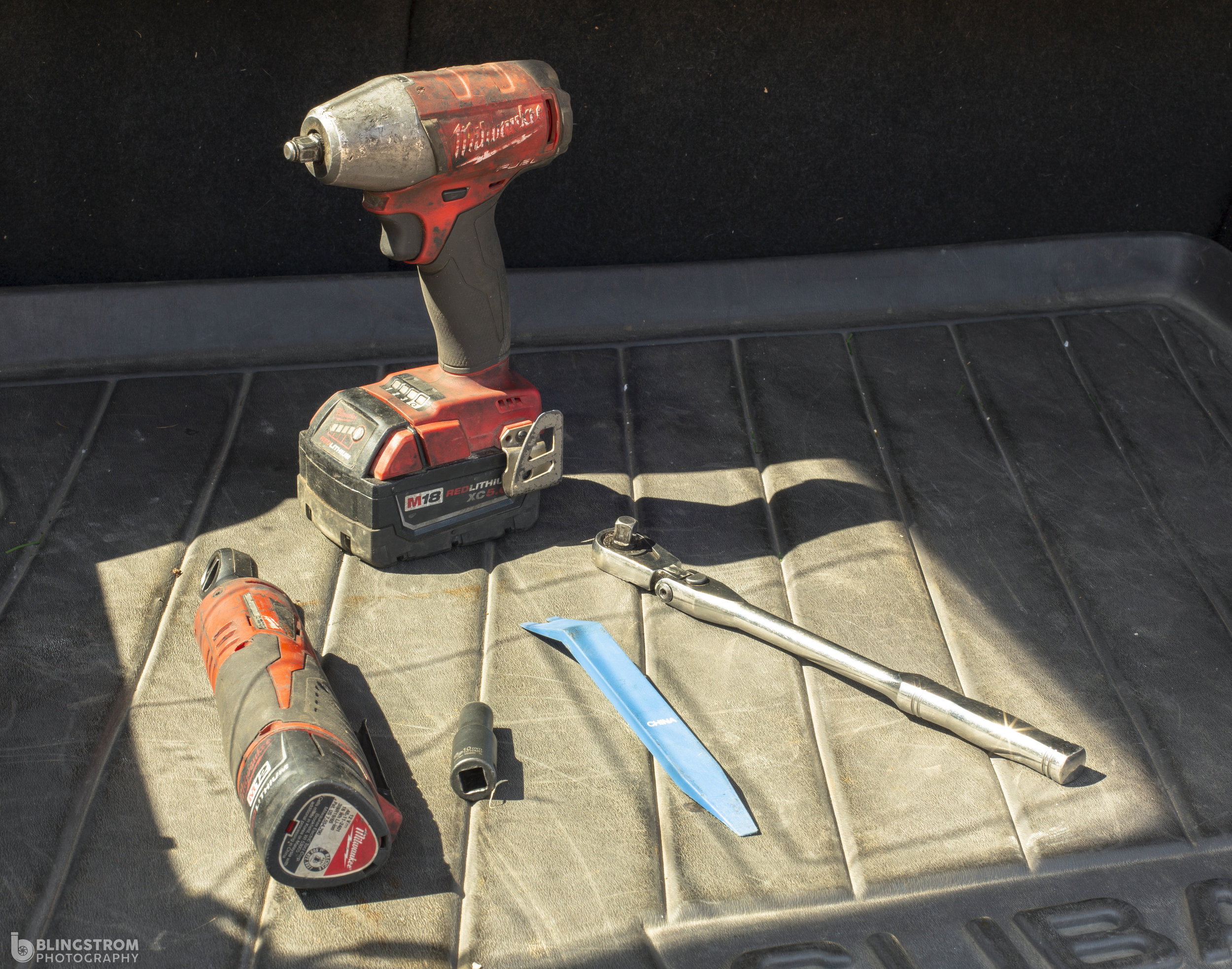 """Tools hanging out in the sun. Milwaukee M18 3/8"""" impact and electric ratchet."""