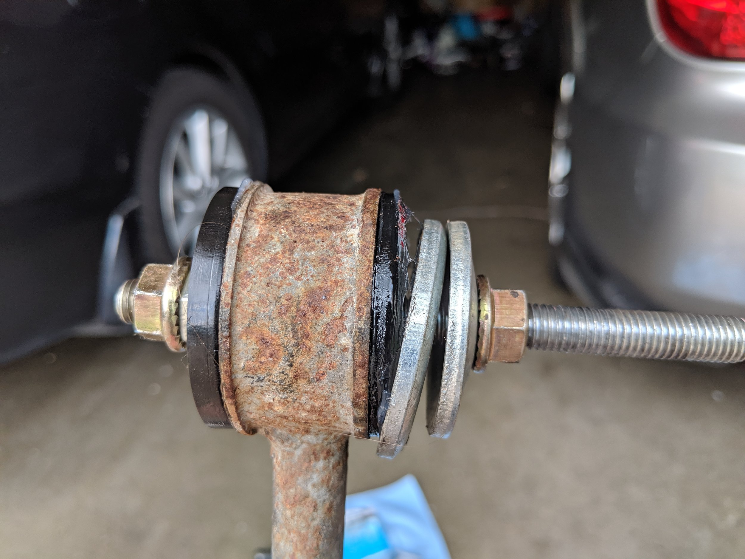 With one nut held with a wrench and one with a ratchet or impact. When you start spinning it down the bushing will slide in and pop into place quickly. With my Milwaukee impact it was to quick job with just two trigger pulls to complete the job.